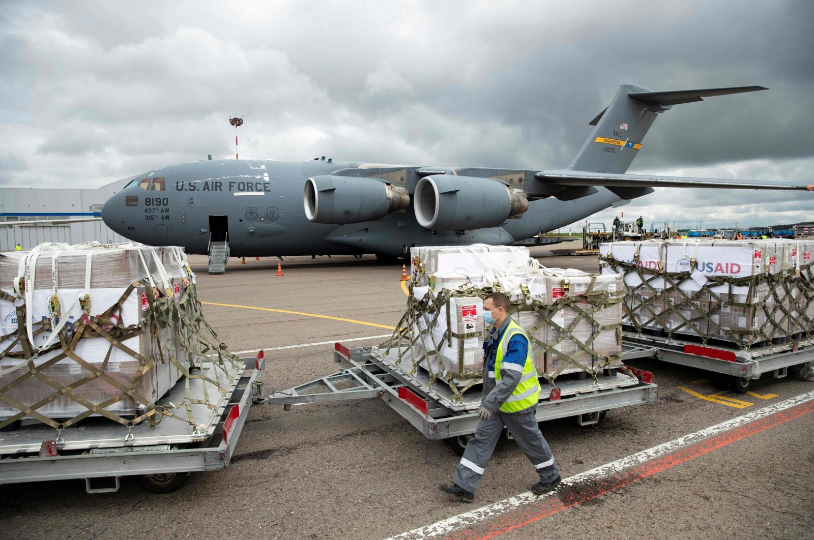 An airport staff member walks past a batch of medical aid donated by the United States, including ventilators, after the landing of a shipment at Vnukovo International Airport outside Moscow, June 4, 2020. (AFP Photo)