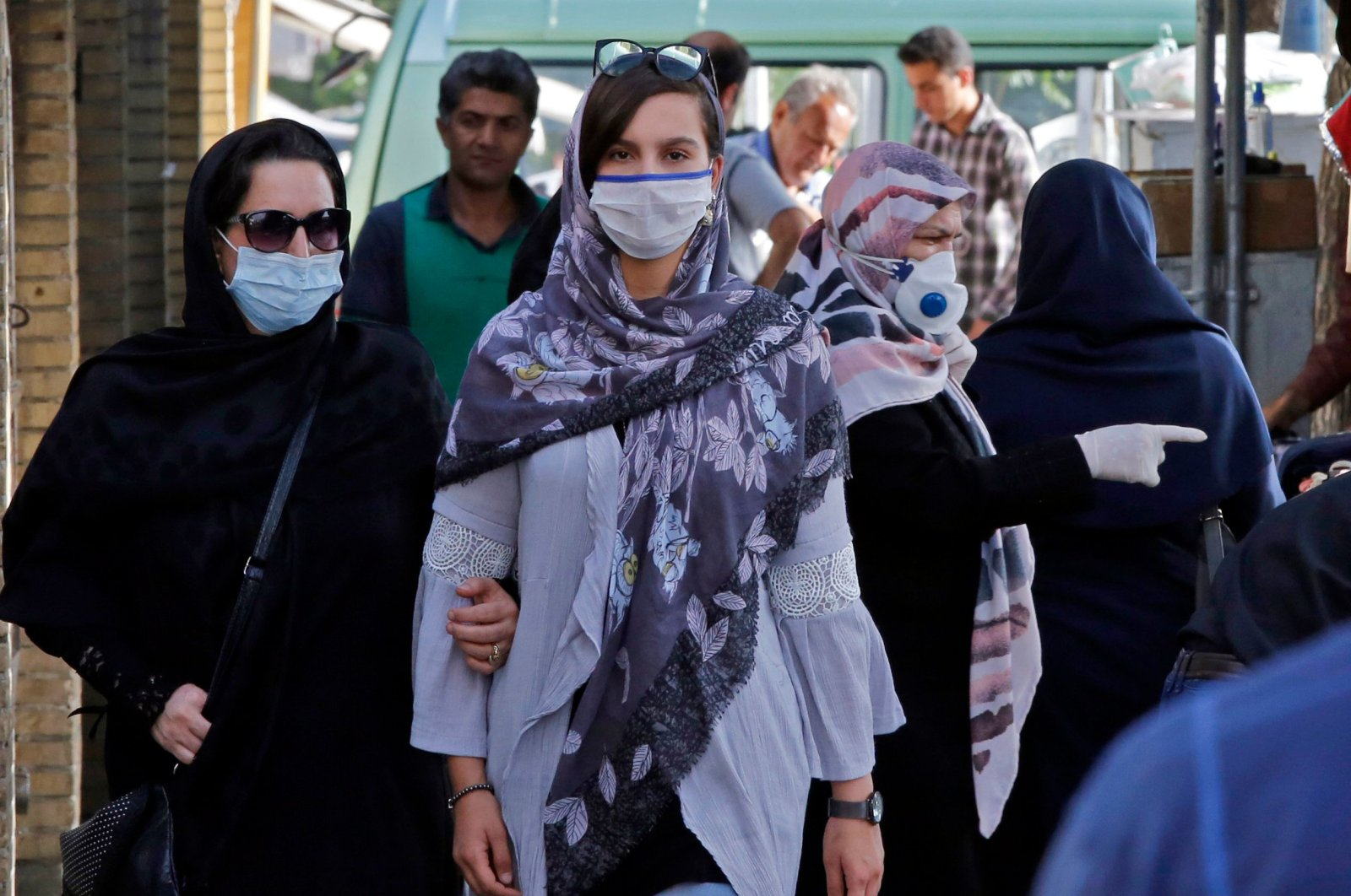 Iranians, some wearing face masks, walk at a market in the capital Tehran, June 3, 2020. (AFP Photo)