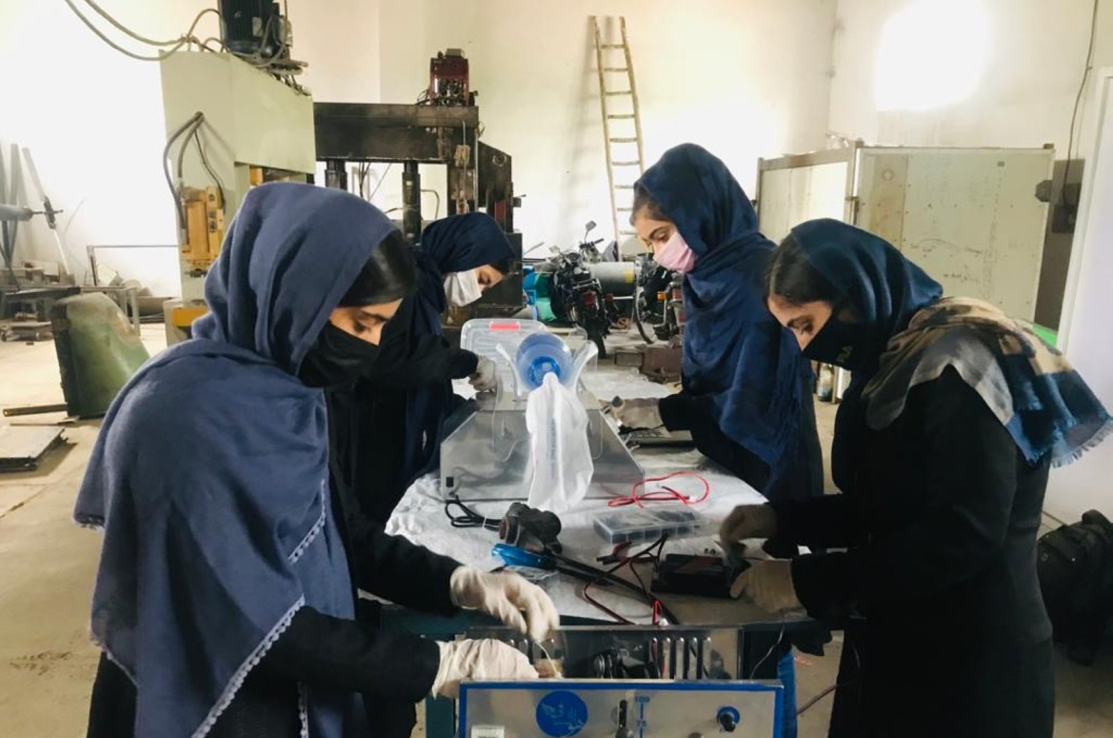 The Afghan Robotics Team works on a prototype breathing machine, Herat, Afghanistan, May 25, 2020. (Thomson Reuters Foundation/courtesy of Somaya Faruqi)