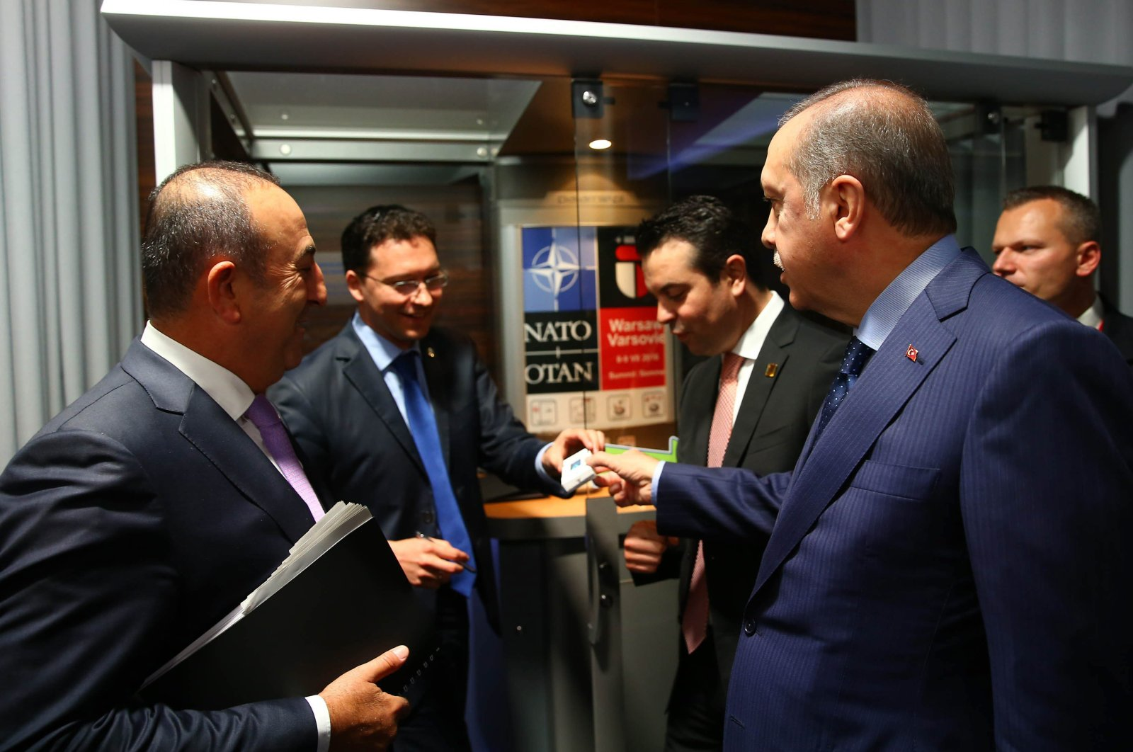 President Recep Tayyip Erdoğan asks Bulgarian Foreign Minister Daniel Mitov to quit smoking on the sidelines of a NATO meeting, in Warsaw, Poland, July 7, 2016. (IHA Photo)