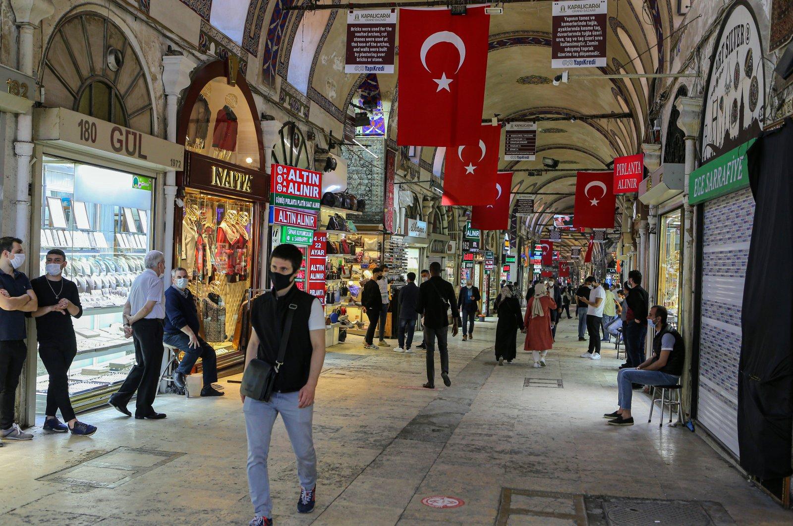 People wearing masks walk in Istanbul's historic Grand Bazaar, Istanbul, June 4, 2020. (AA)