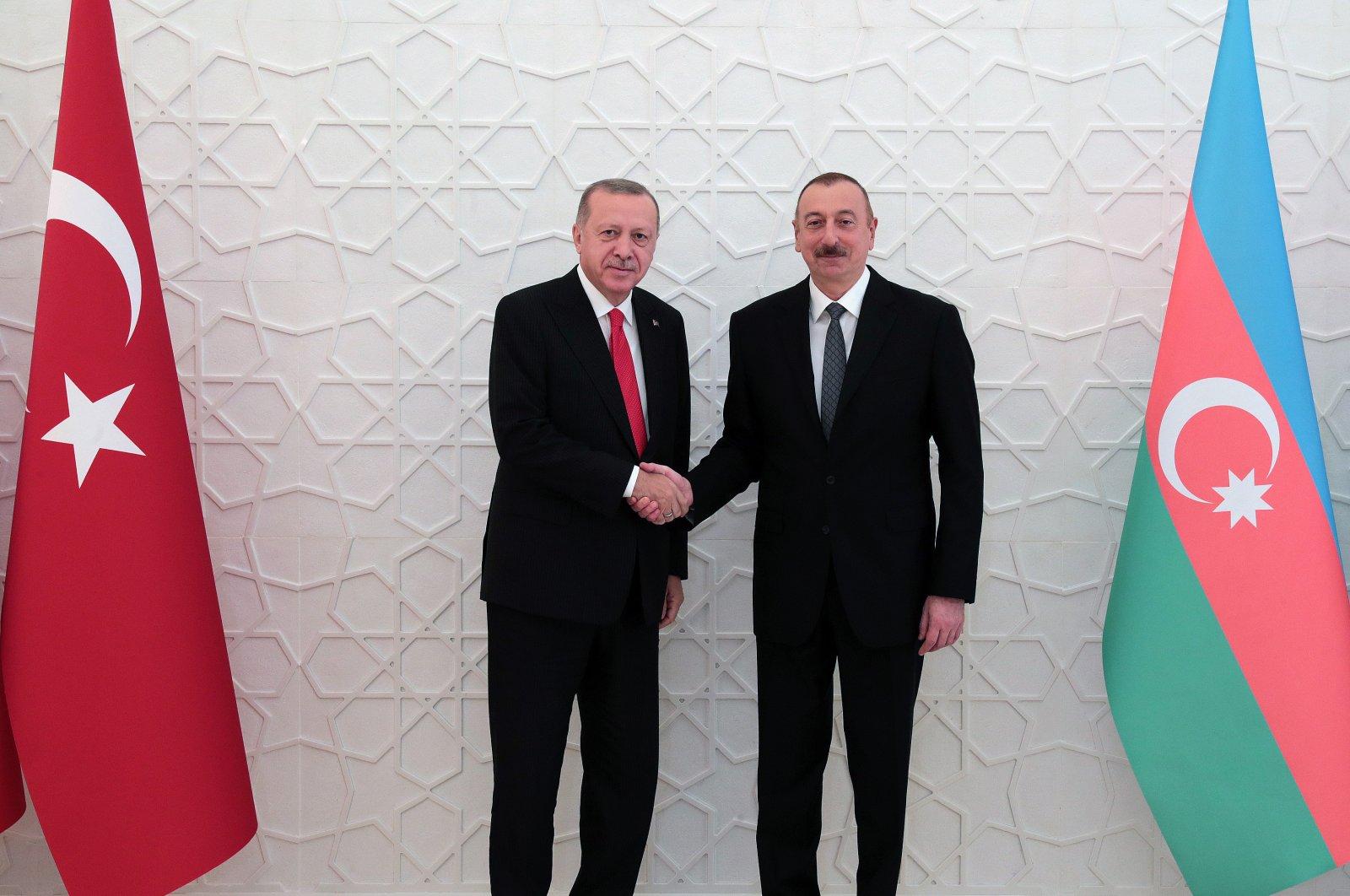 President Recep Tayyip Erdoğan shakes hand with Azeri President Ilham Aliyev, Baku, Nov. 15, 2019. (AA)