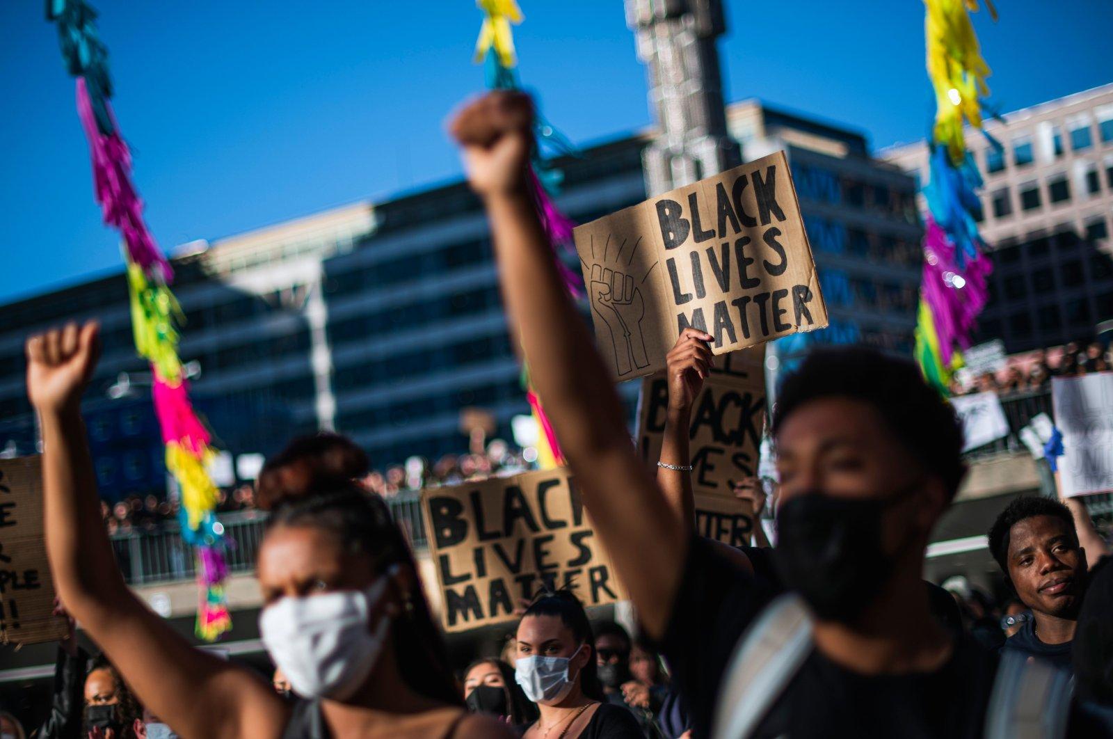 Protesters raise their fists during a Black Lives Matter demonstration in Stockholm, Sweden, June 3, 2020. (AFP)