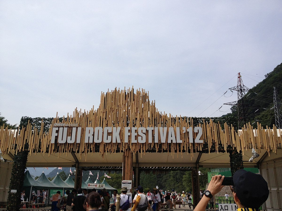 People walk to the entrance gate of the Fuji Rock Festival in 2012.