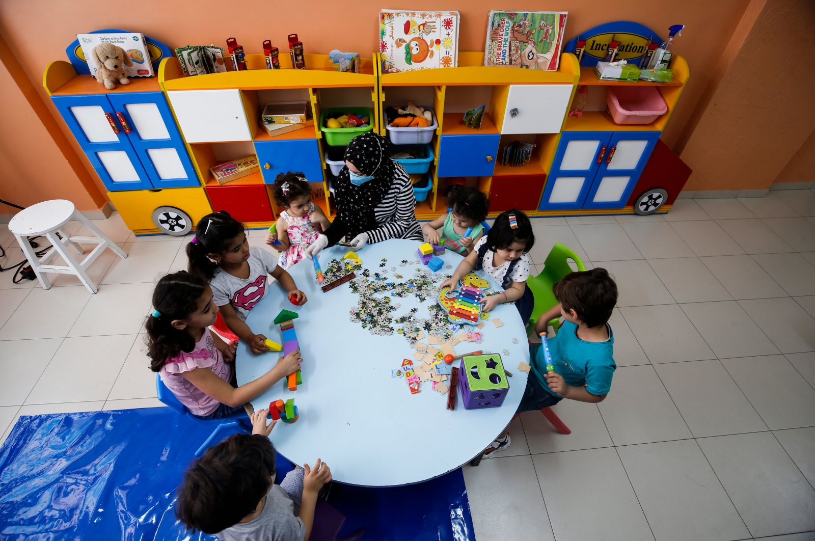 Palestinian children are pictured in a preschool in Gaza City following the easing of restrictions to curb the spread of the coronavirus, Palestine, June 4, 2020. (AFP Photo)