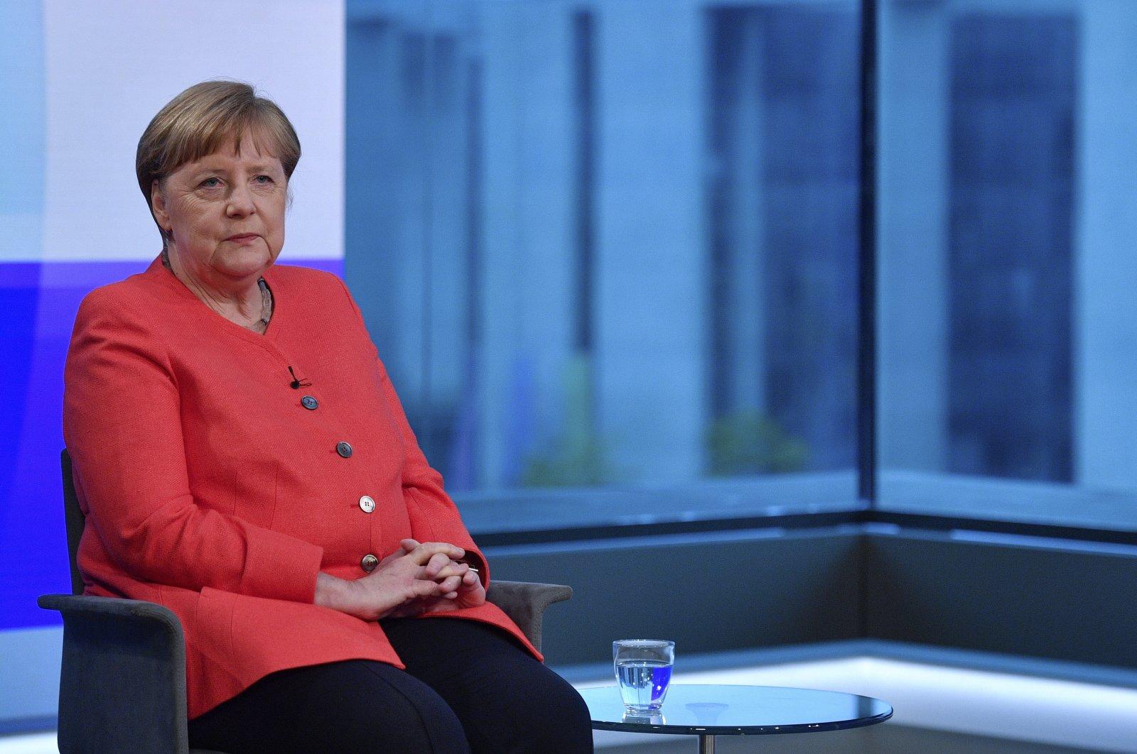 German Chancellor Angela Merkel, ahead of a televised interview at the ARD-Hauptstadtstudio of public broadcaster ARD, Berlin, Germany, June 4, 2020. (AP Photo)