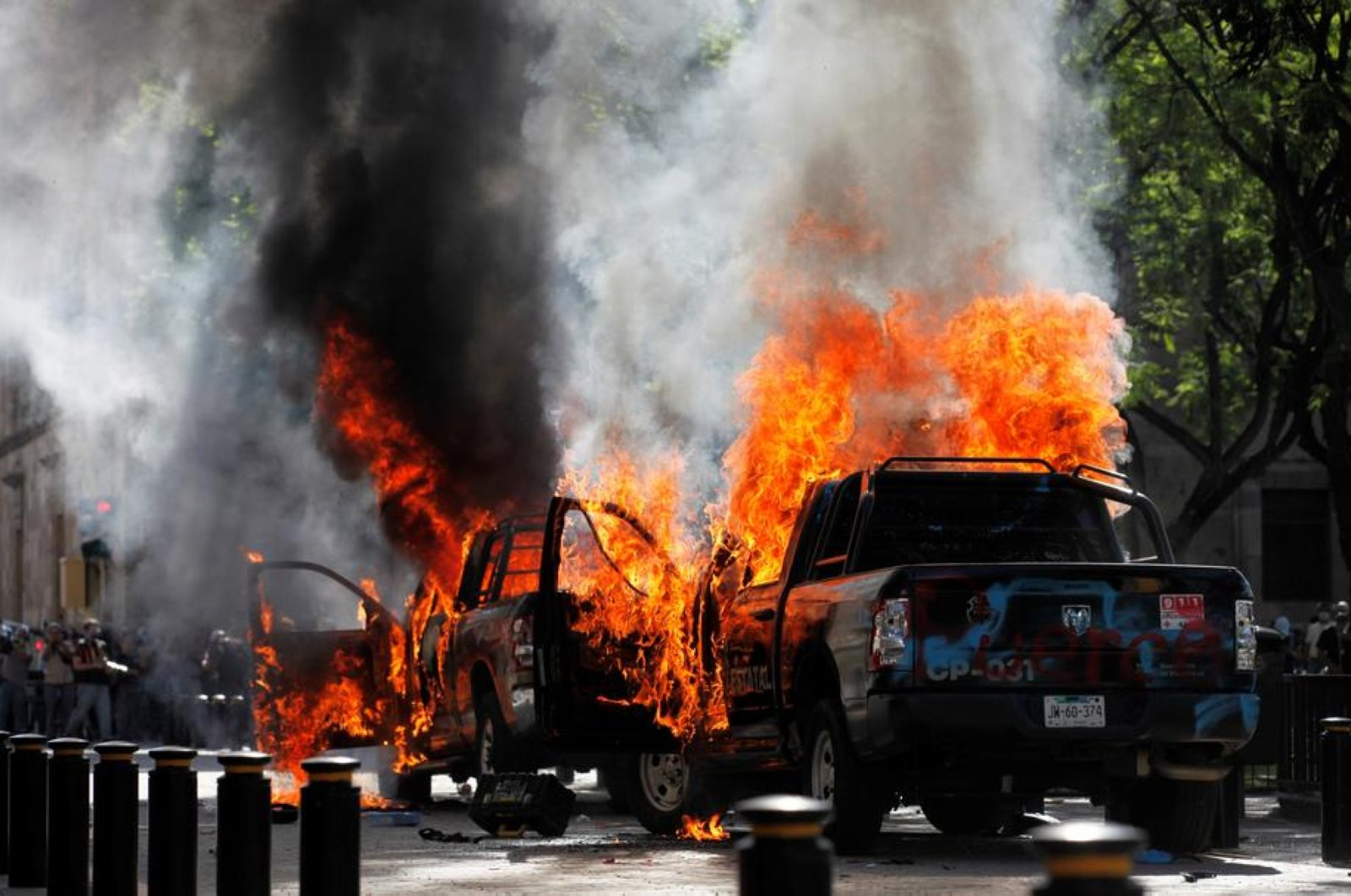 Two police cars burn after they were set on fire during a protest following the death of Giovanni Lopez, Guadalajara, Mexico, June 4, 2020. (EPA Photo)