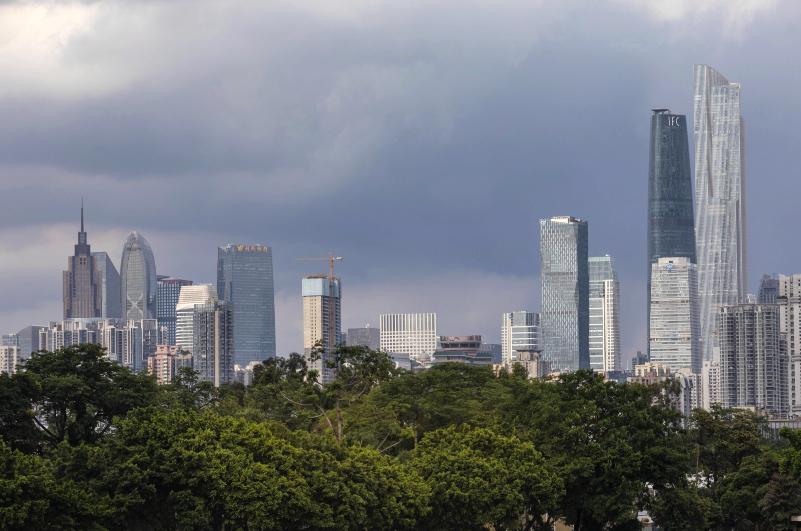 General view of Guangzhou city centre is seen behind the trees in Guangzhou, Guangdong province, China, June 4, 2020. (EPA Photo)