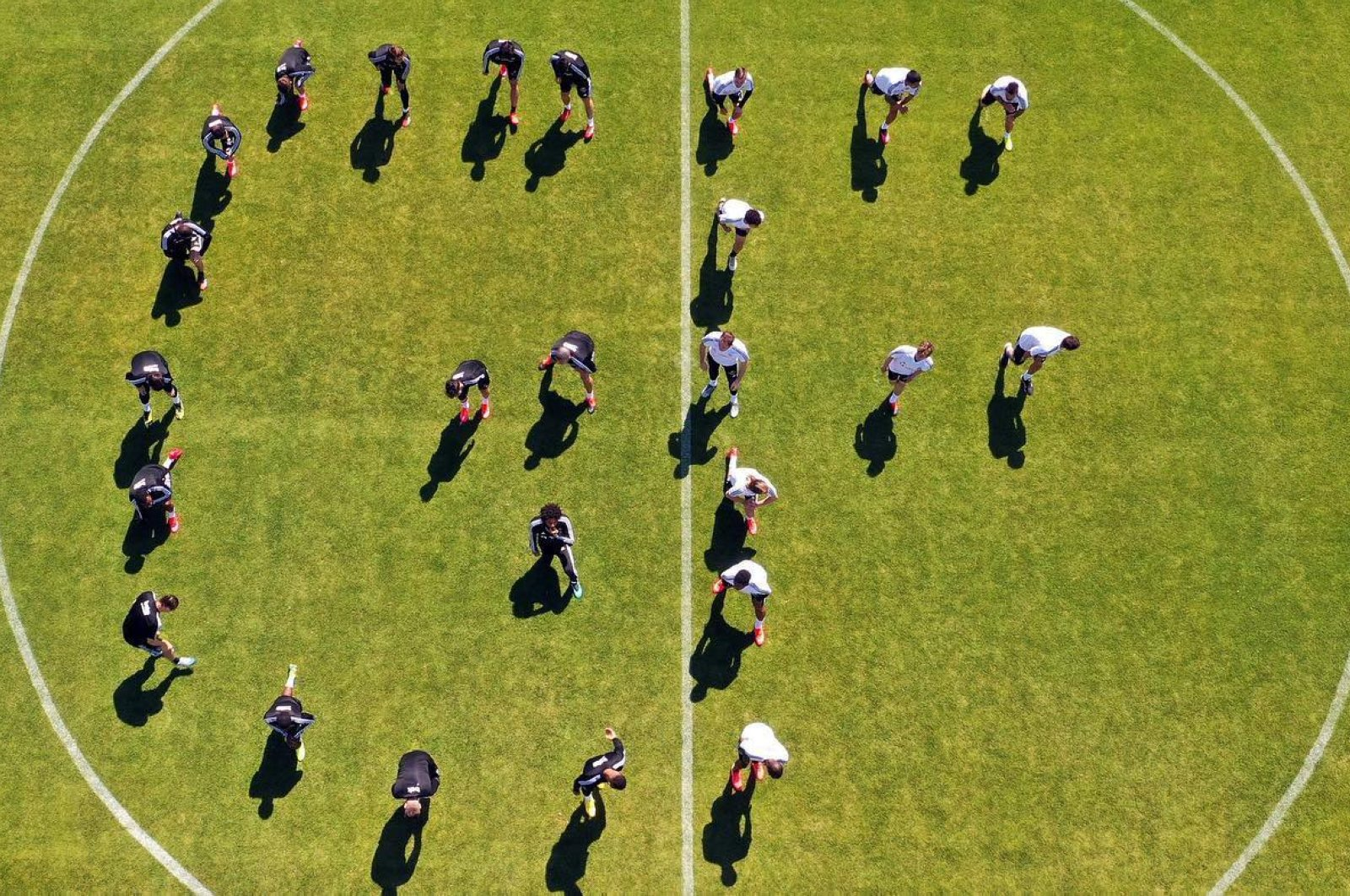 Beşiktaş players spell out George Floyd's initials during a training session in Istanbul, Turkey, June 6, 2020. (AA Photo)
