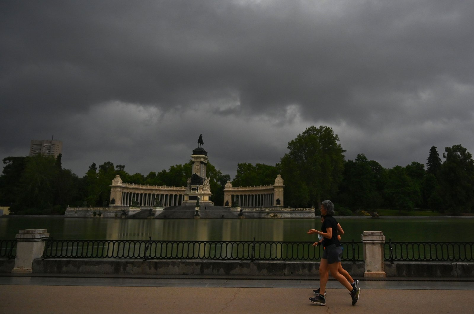 People run at the Retiro park in Madrid, June 4, 2020 in Madrid. (AFP Photo)