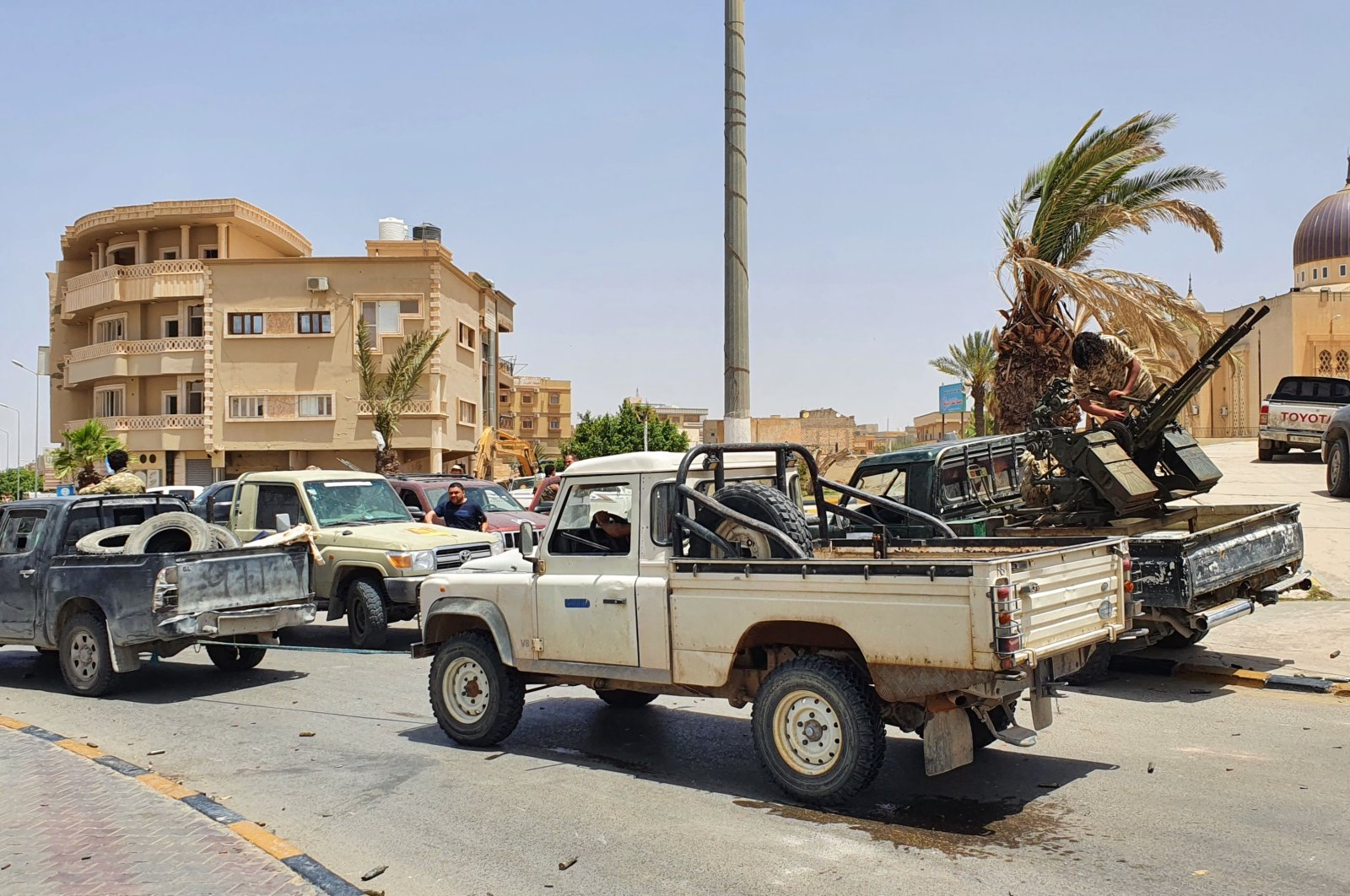 Fighters loyal to Libya's internationally recognized government celebrate after regaining control over Tarhuna city, Libya, June 5, 2020. (Anadolu Agency Photo)