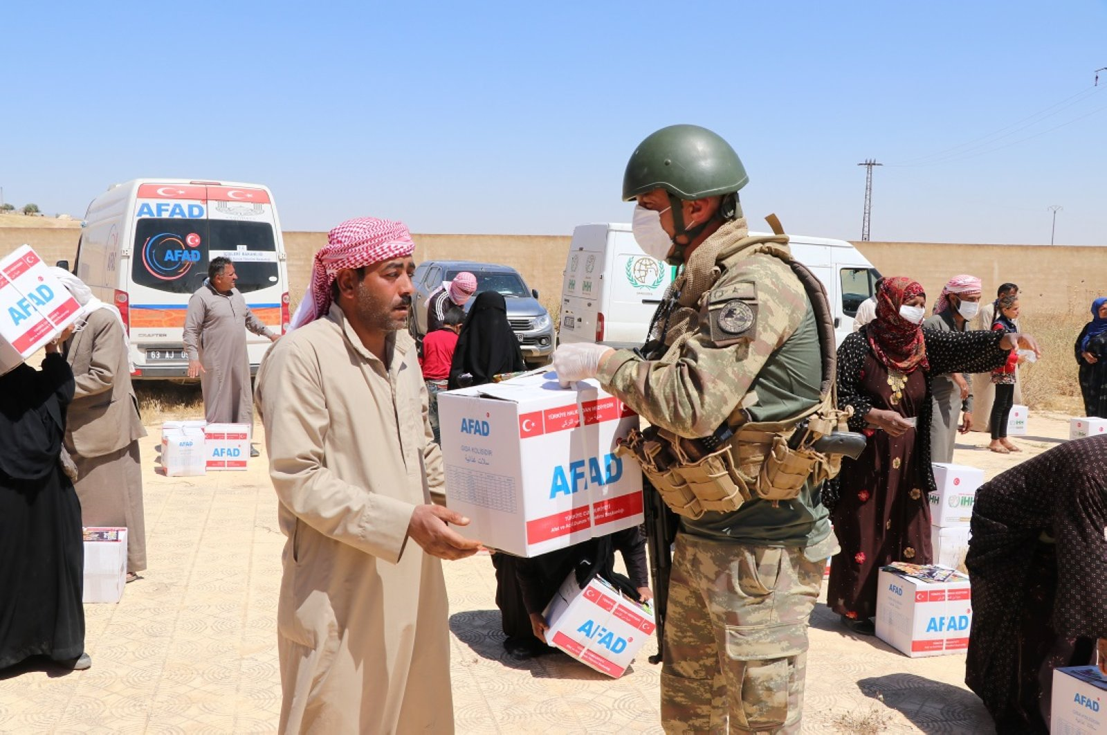 The Disaster and Emergency Management Authority (AFAD) distributed food aid in six villages of Tal Abyad, northern Syria, June 5, 2020. (AA Photo)