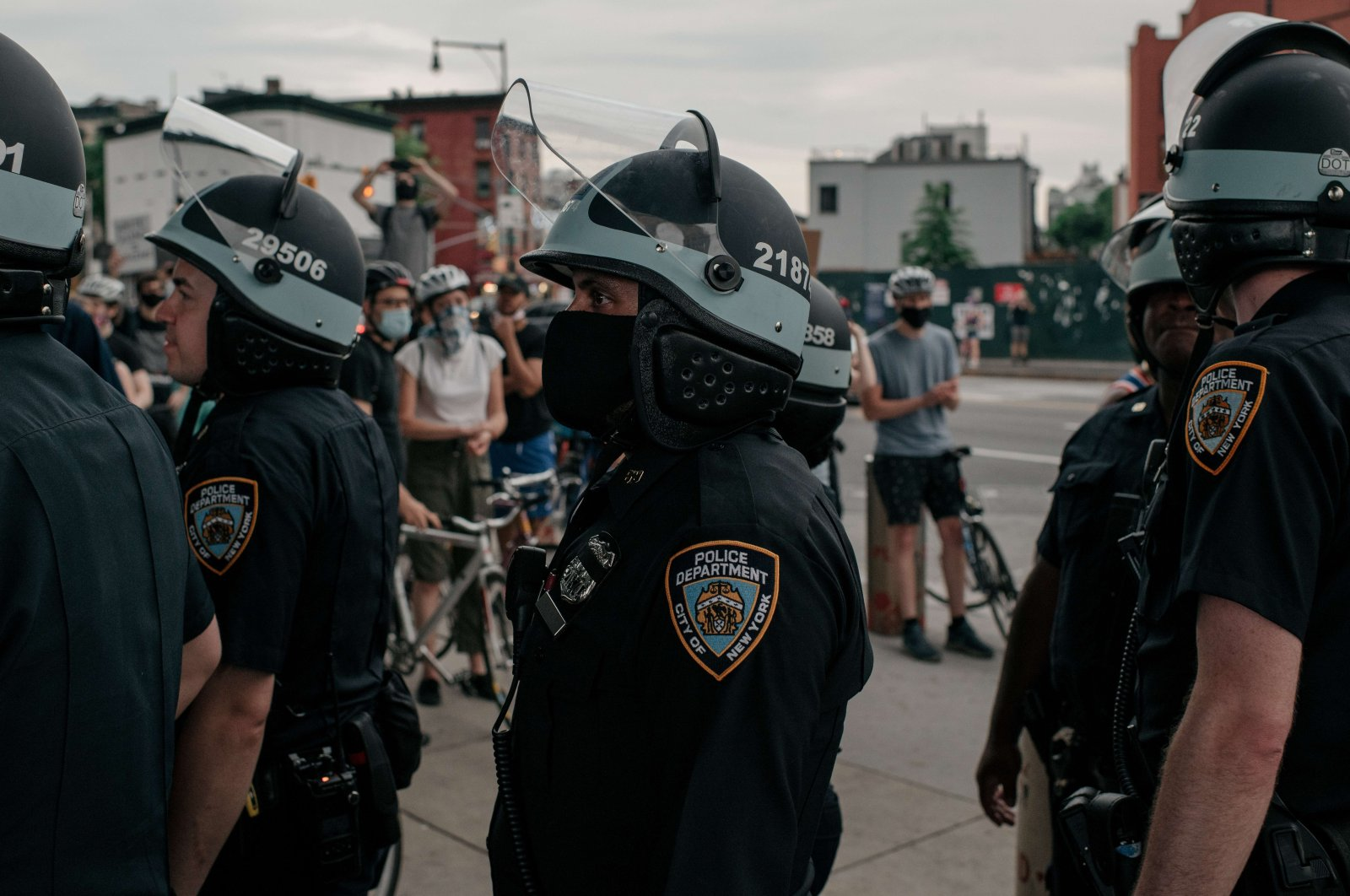 NYPD officers stand in line near a demonstration denouncing systemic racism in law enforcement in the borough of Brooklyn minutes before a citywide curfew went into effect on June 4, 2020 in New York City. (AFP Photo)