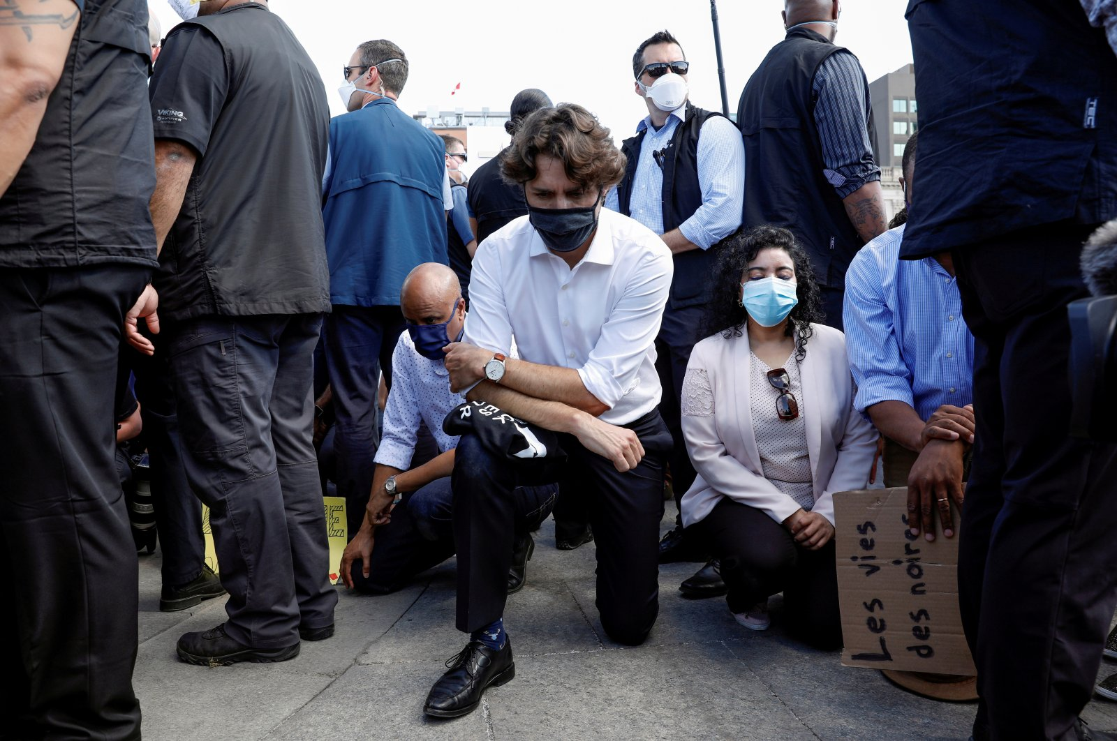 Canada's Prime Minister Justin Trudeau wears a mask as he takes a knee during a rally against the death in Minneapolis police custody of George Floyd, on Parliament Hill, in Ottawa, Ontario, Canada June 5, 2020. (Reuters Photo)