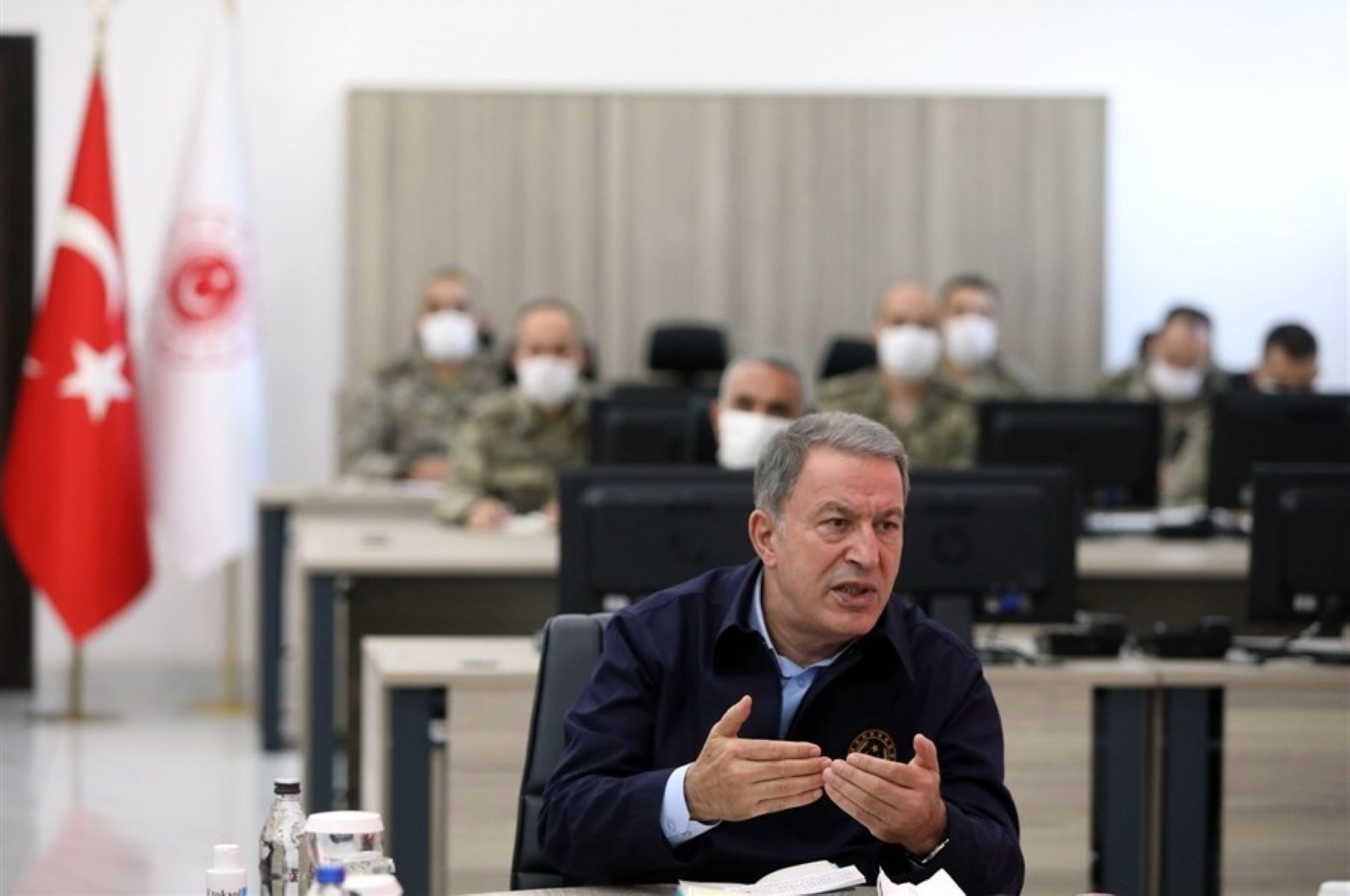 Defense Minister Hulusi Akra speaks in a meeting with land, air and naval forces commanders, June 5, 2020. (IHA Photo)