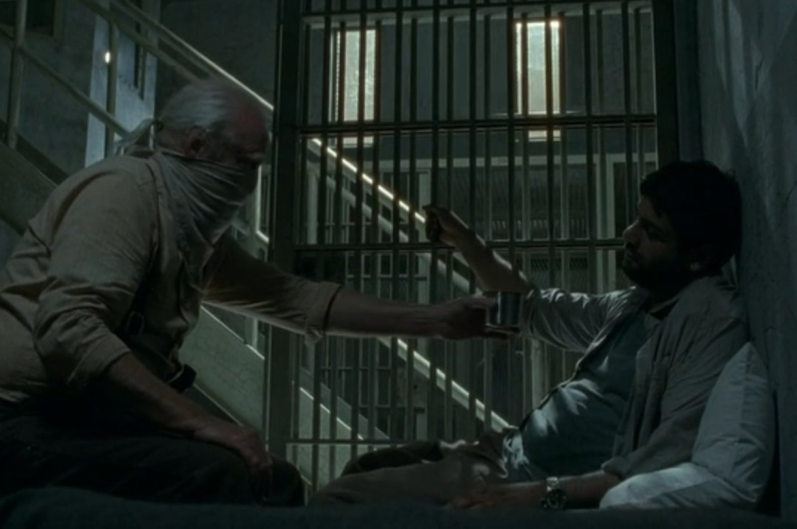 A still from season 4 episode 3 shows Hershel and Dr. Caleb.
