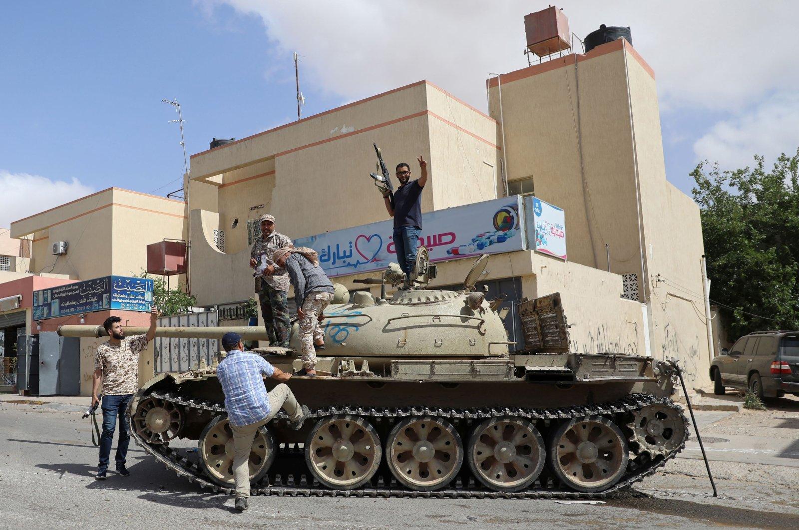 Fighters loyal to Libya's internationally recognized government celebrate after regaining control over Tarhuna city, Libya, June 5, 2020. (Reuters Photo)
