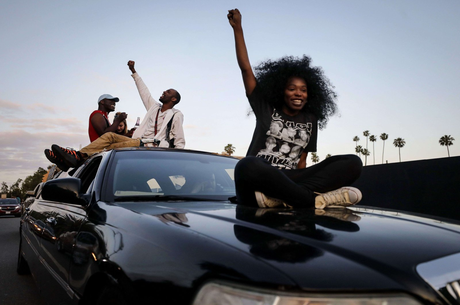 Protesters ride atop a limousine in a march toward Hollywood Boulevard during a peaceful demonstration against racism and police brutality, Los Angeles, California, June 6, 2020. (AFP Photo)