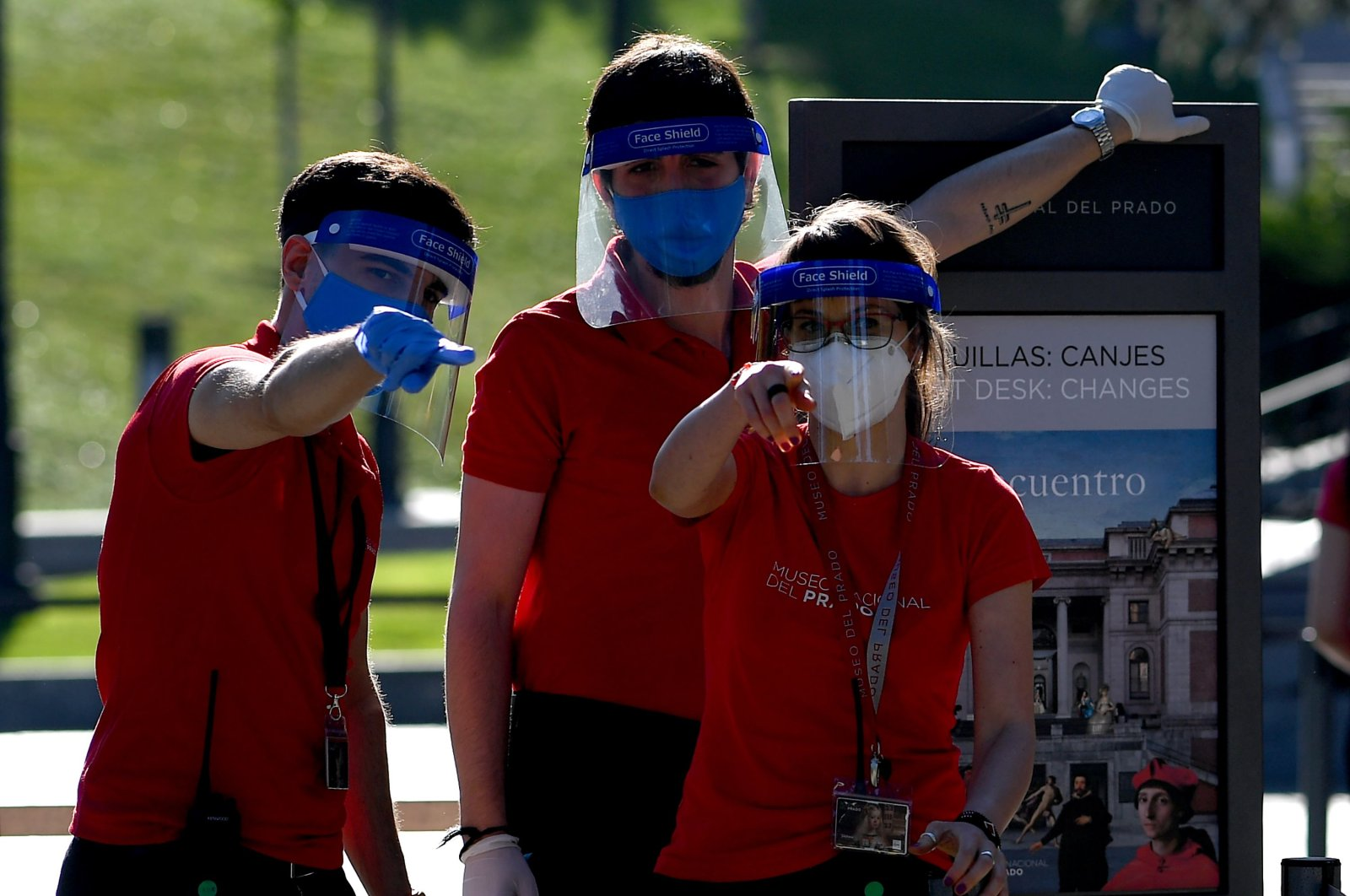 Employees wearing face masks and shields place information panels outside The Prado Museum in Madrid, on June 6, 2020. (AFP Photo)