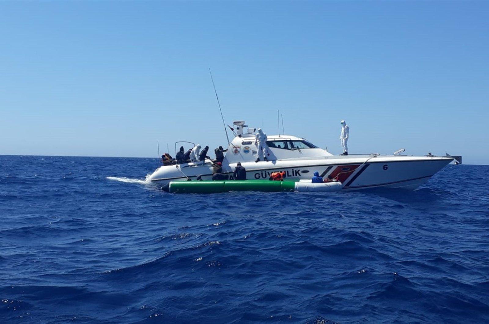 The Turkish Coast Guard rescued 100 asylum-seekers off the Aegean Sea coast of Çanakkale's Ayvacık district, June 6, 2020. (AA Photo)
