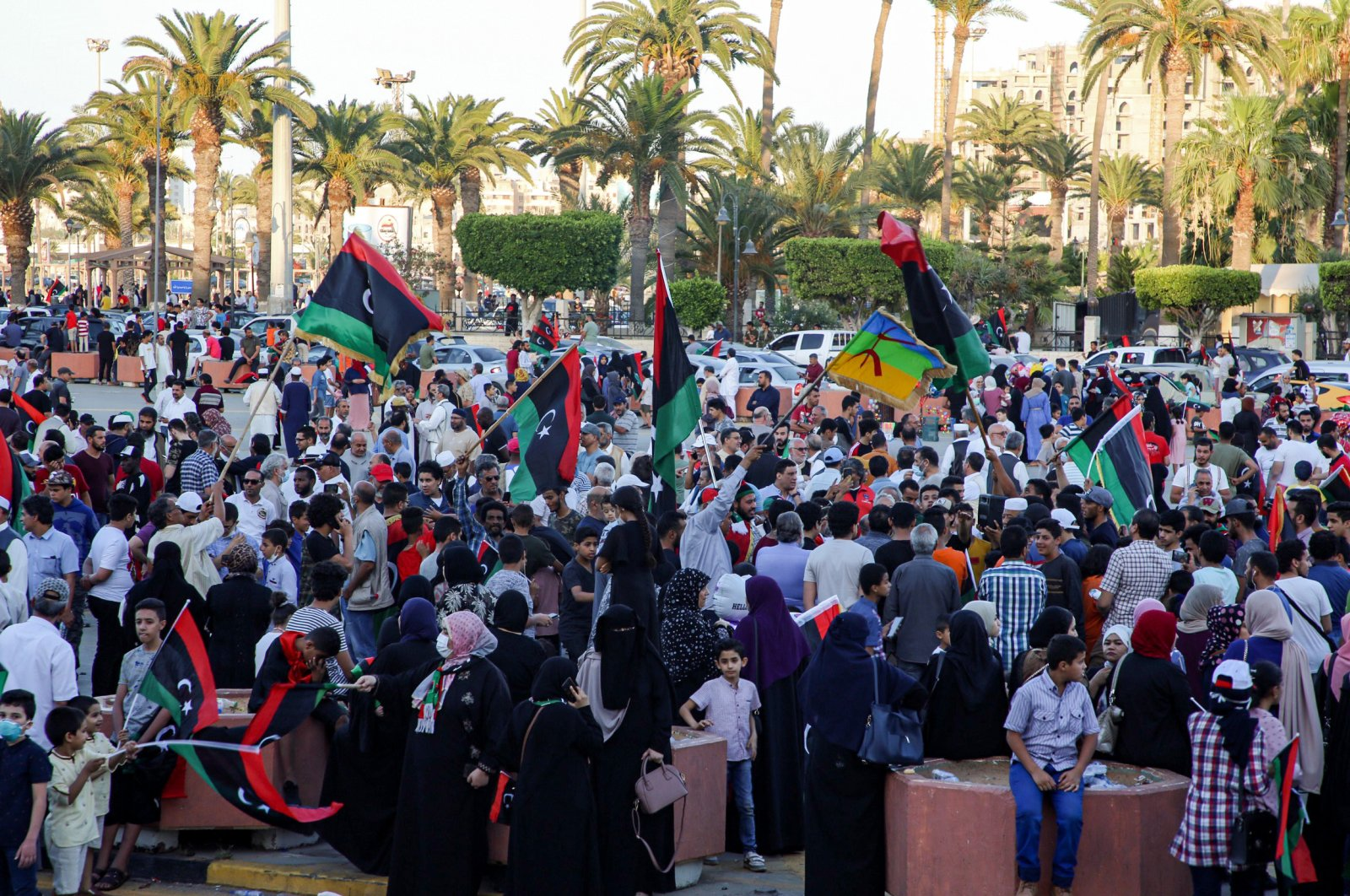 People celebrate with Libyan national flags in the capital Tripoli's Martyrs' Square on June 5, 2020, after fighters loyal to the UN-recognised Government of National Accord (GNA) captured the town of Tarhuna. (AFP Photo)