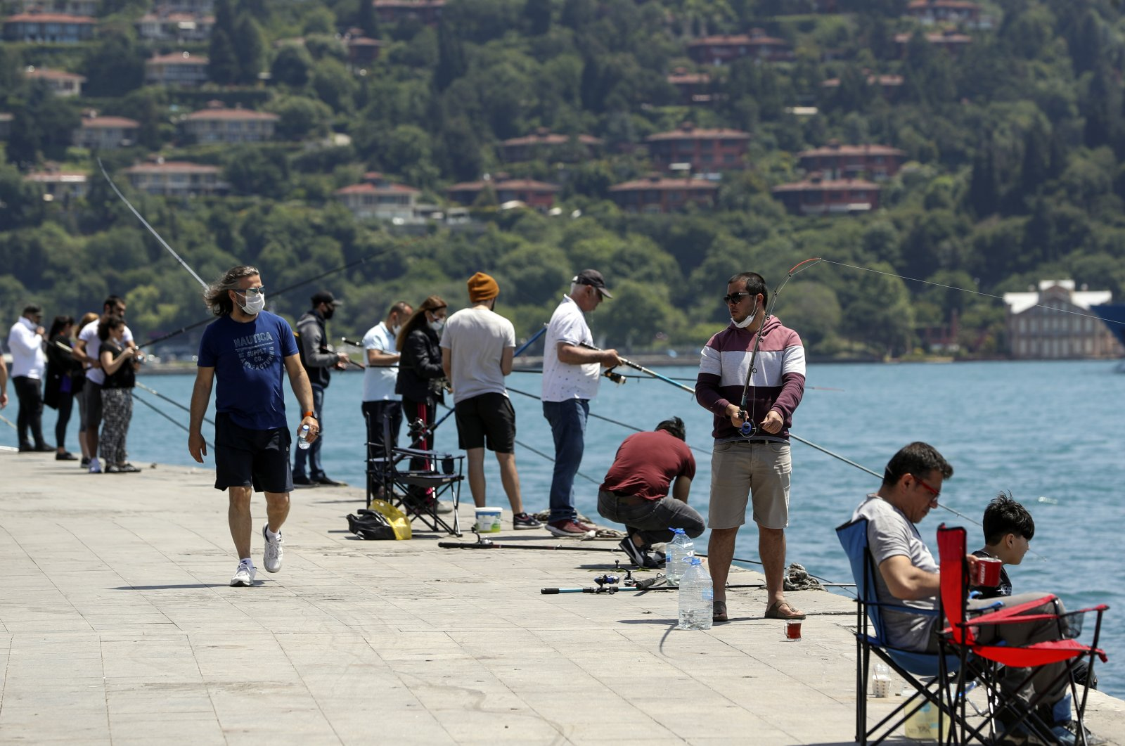 Some went fishing, others for a walk and some preferred simply watching the scenic Bosporus on the first weekend without a curfew, Istanbul, Turkey, June 7, 2020. (AA Photo)