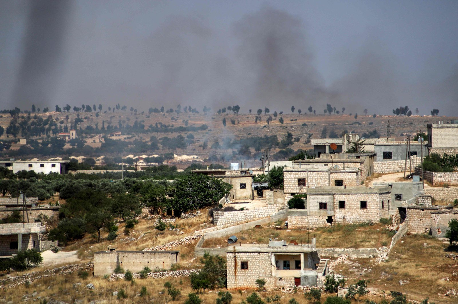 Smoke plumes rise following shelling by pro-Syrian regime forces in the town of Banin, north of Maarat al-Numan in northwestern Idlib province, Syria, June 4, 2020. (AFP Photo)