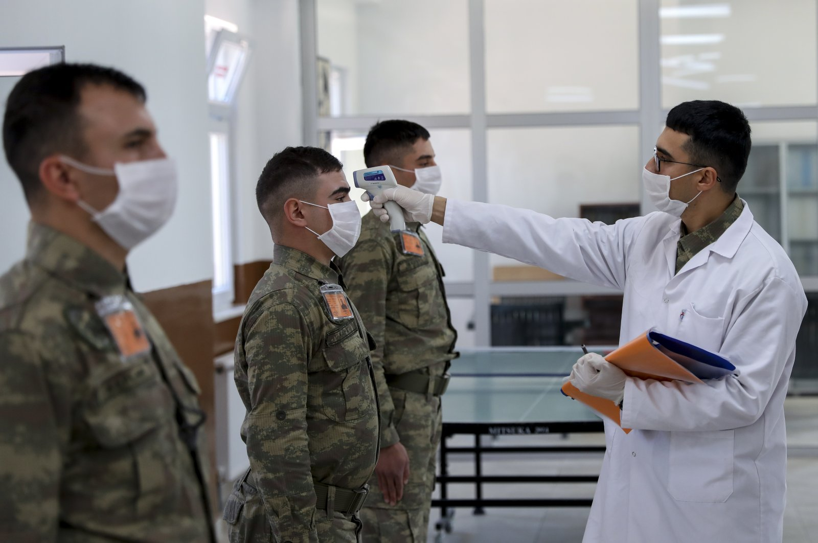 A doctor checks the body temperature of Turkish soldiers in this undated photo. (AA Photo)