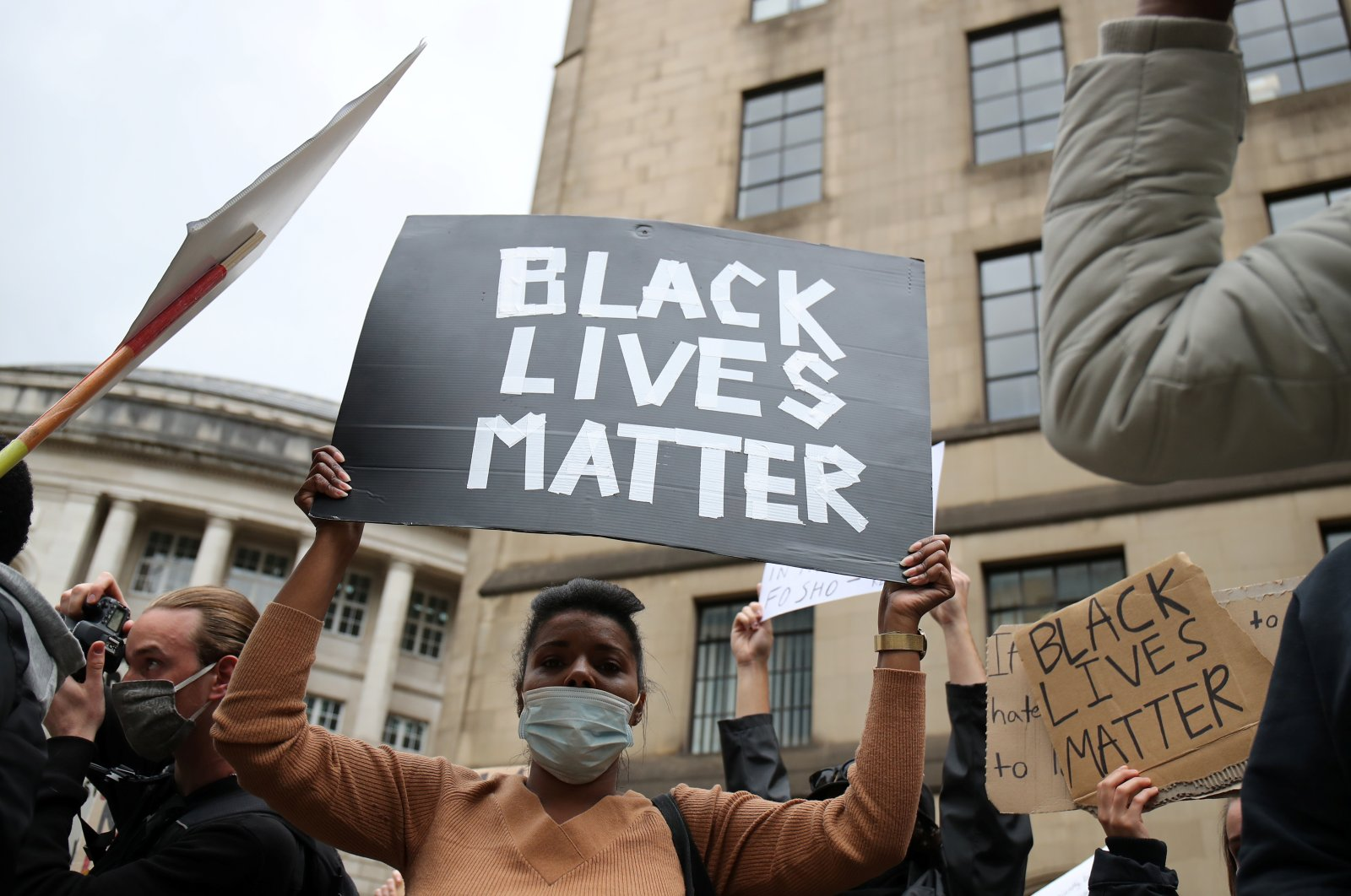 A demonstrator holds a sign during a Black Lives Matter protest in Manchester, following the death of George Floyd who died in police custody in Minneapolis, Manchester, Britain, June 7, 2020. (Reuters Photo)
