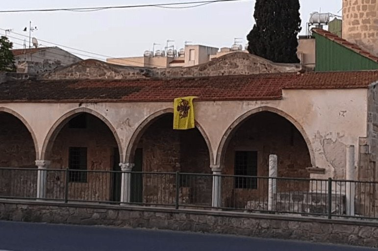 A Byzantine flag is seen hanging on Tuzla Mosque in Larnaca, Greek Cyprus, June 7, 2020. (DHA Photo)