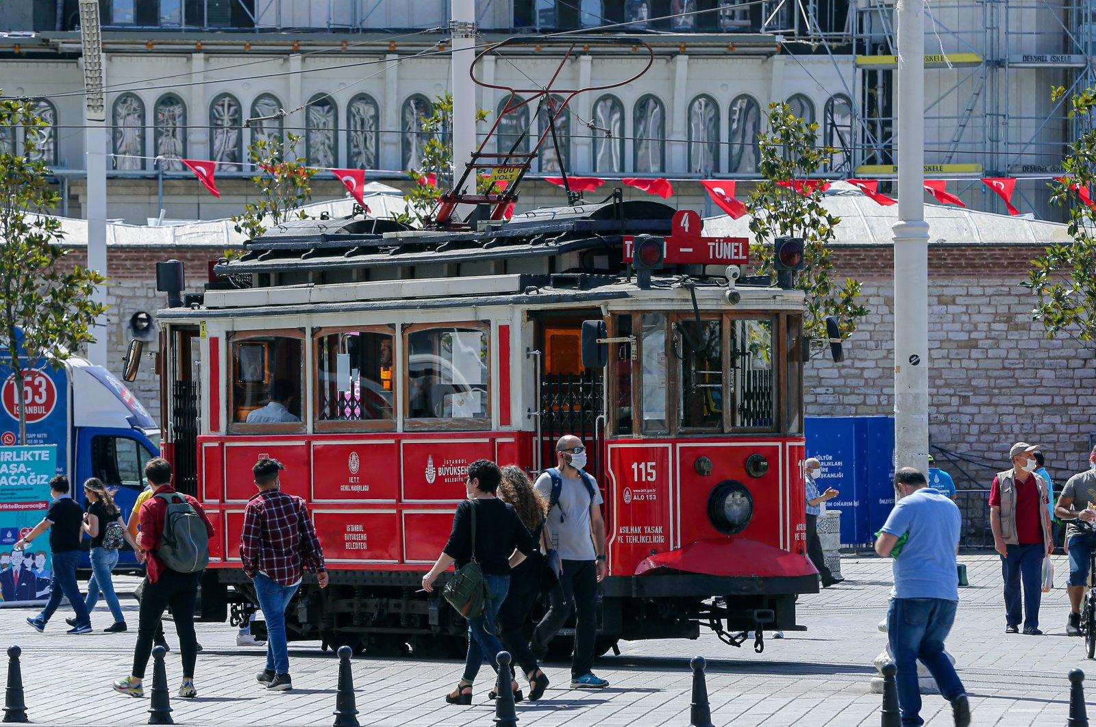 Pedestrians walk in Taksim Square, Istanbul, Turkey, June 6, 2020. (AA Photo)