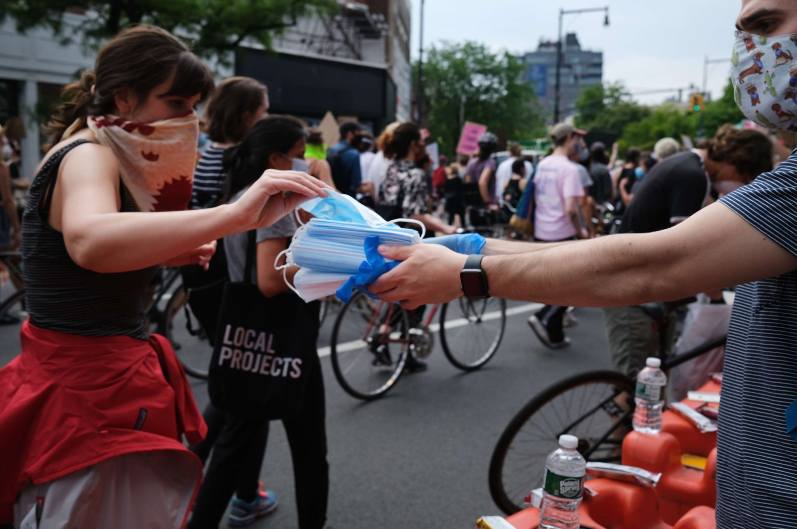 Face masks are handed out as hundreds of protesters march in downtown Brooklyn over the killing of George Floyd by a Minneapolis Police officer on June 5, 2020, in New York City, New York, U.S. (Getty Images/AFP)