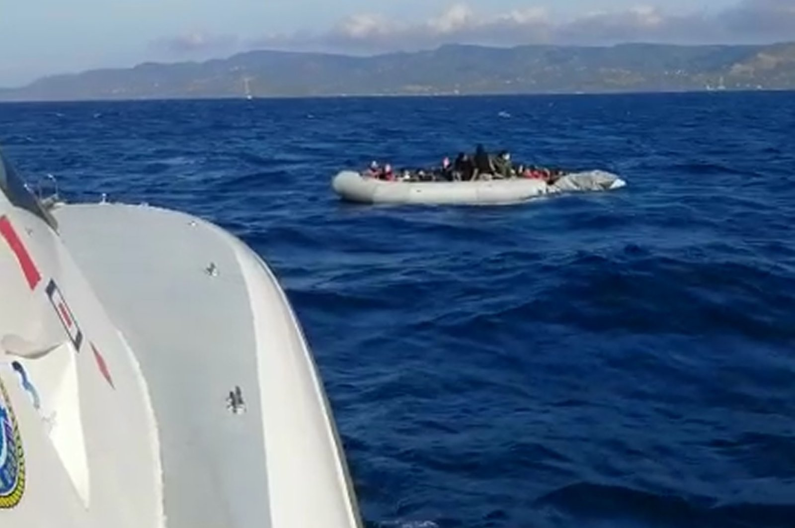 The Turkish Coast Guard arrives to rescue a boat of migrants and refugees off the Aegean Sea coast of Çanakkale's Ayvacık district, June 6, 2020. (DHA Photo)