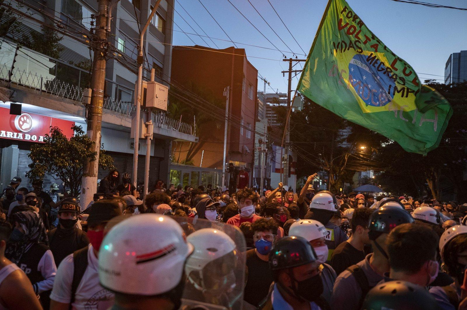 Demonstrators protest against racism and Brazilian president Jair Bolsonaroand in Sao Paulo, Brazil, Sunday, June 7, 2020. (AP Photo/Andre Penner)