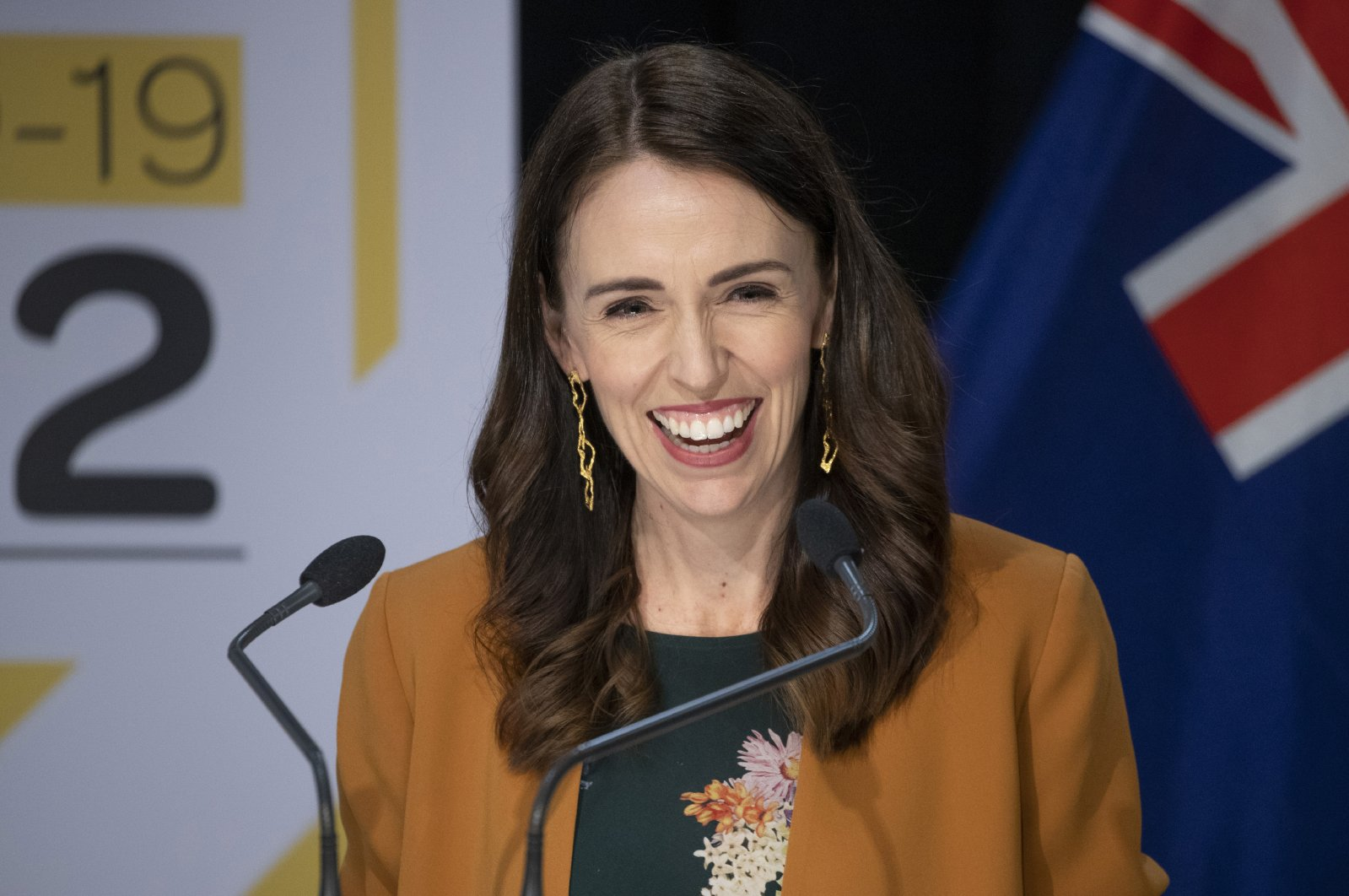 New Zealand Prime Minister Jacinda Ardern smiles as she addresses a press conference where she announced New Zealand will drop to COVID-19 alert level 1 at midnight in Wellington, New Zealand, Monday, June 8, 2020 (Mark Mitchell/New Zealand Herald via AP)