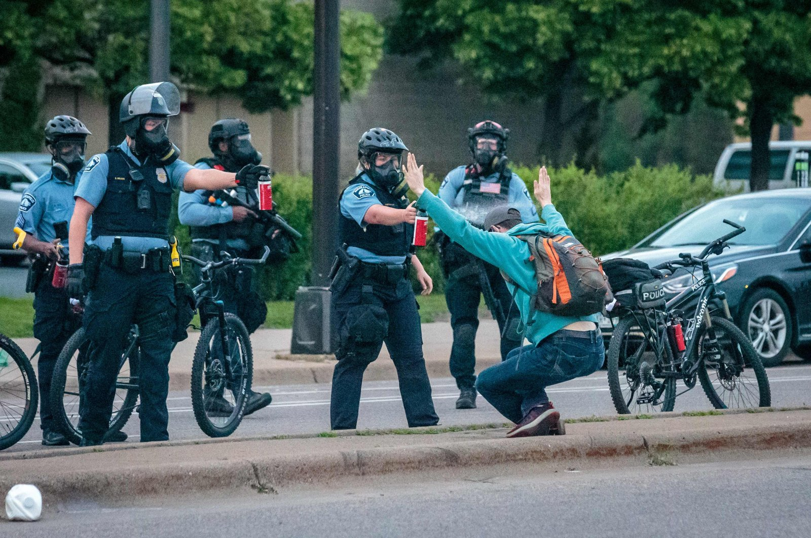 Demonstrator holds up his hands as he is sprayed with pepper spray by two Minneapolis Police officers in Minneapolis, Minnesota during a protest over the death of George Floyd, an unarmed black man who died while in police custody in Minneapolis, May 31, 2020. (AFP Photo)