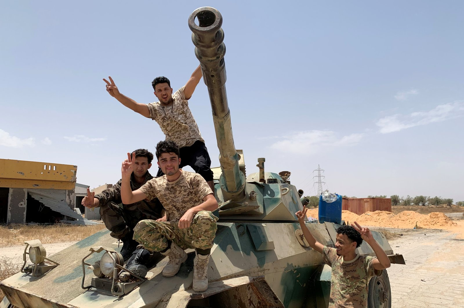 Fighters loyal to Libya's internationally recognized government celebrate after regaining control over the city, in Tripoli, Libya, June 4, 2020. (Reuters File Photo)