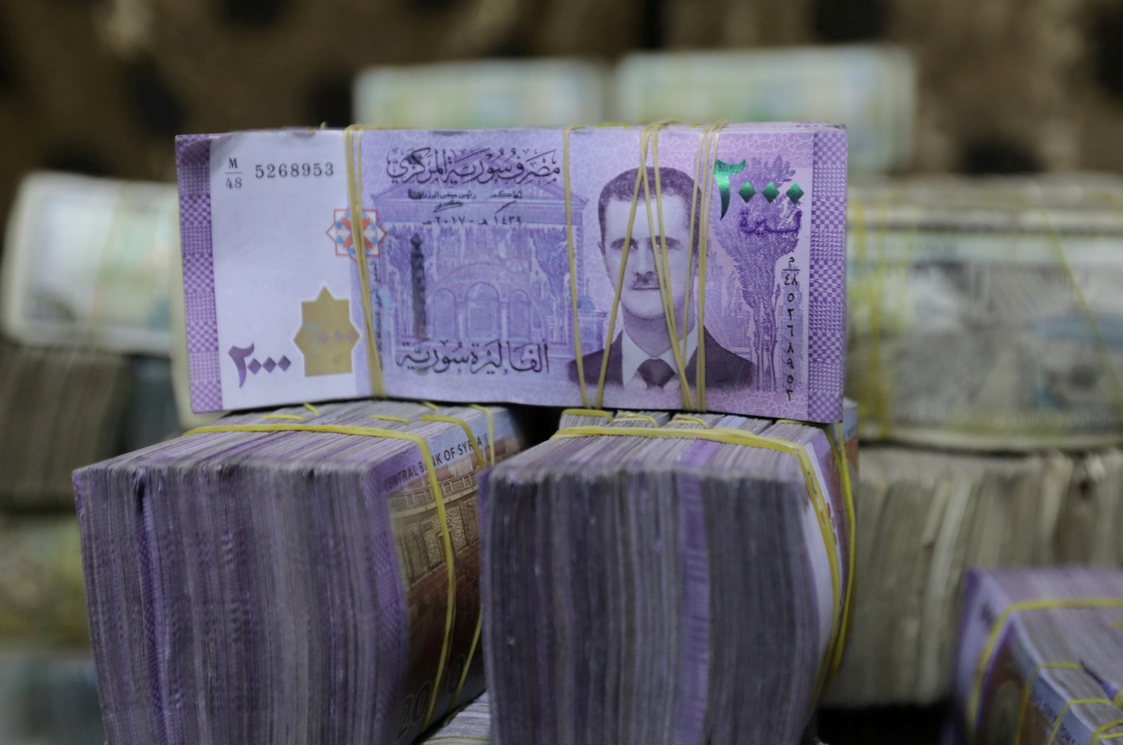 Syrian pounds are pictured inside an exchange currency shop in Azaz, Syria, Feb. 3, 2020. (REUTERS File Photo)