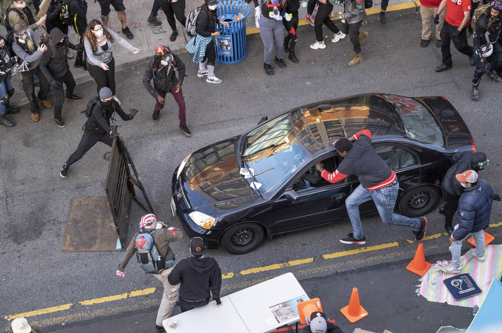 A man drives into the crowd at 11th and Pike, injuring at least one person, Seattle, June 7, 2020. (AP Photo)