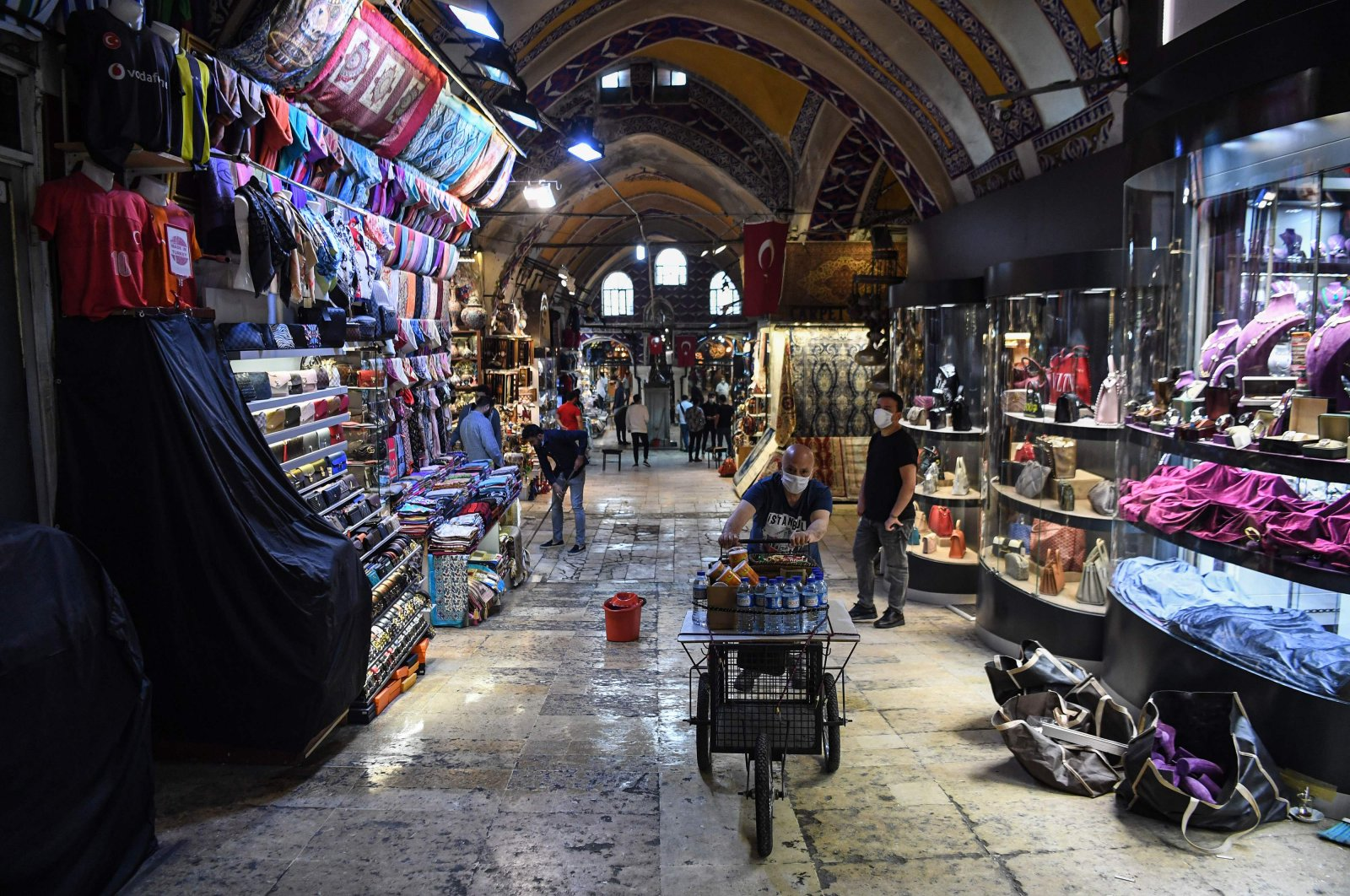 Shop owners wearing protective face masks work at Istanbul's iconic Grand Bazaar, Turkey, June 1, 2020. (AFP Photo)