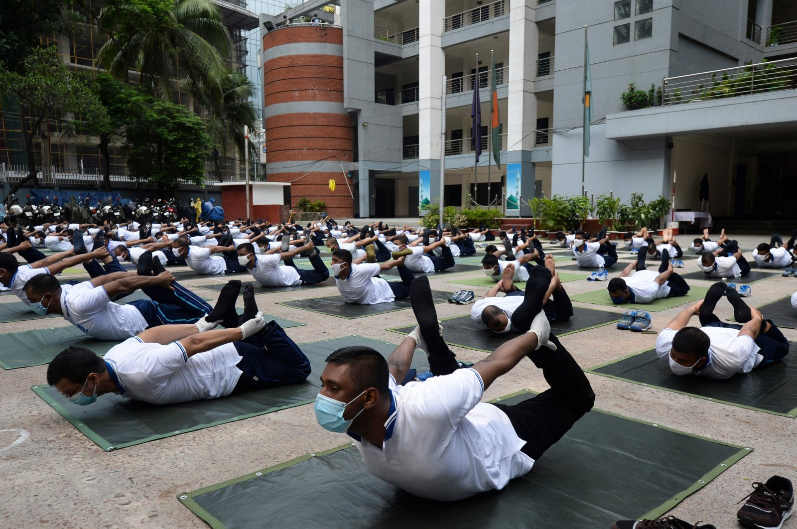 Members of a Bangladeshi police force attend a yoga session to boost the immune system of police personnel during the coronavirus pandemic, in Dhaka, July 8, 2020. (AFP Photo)