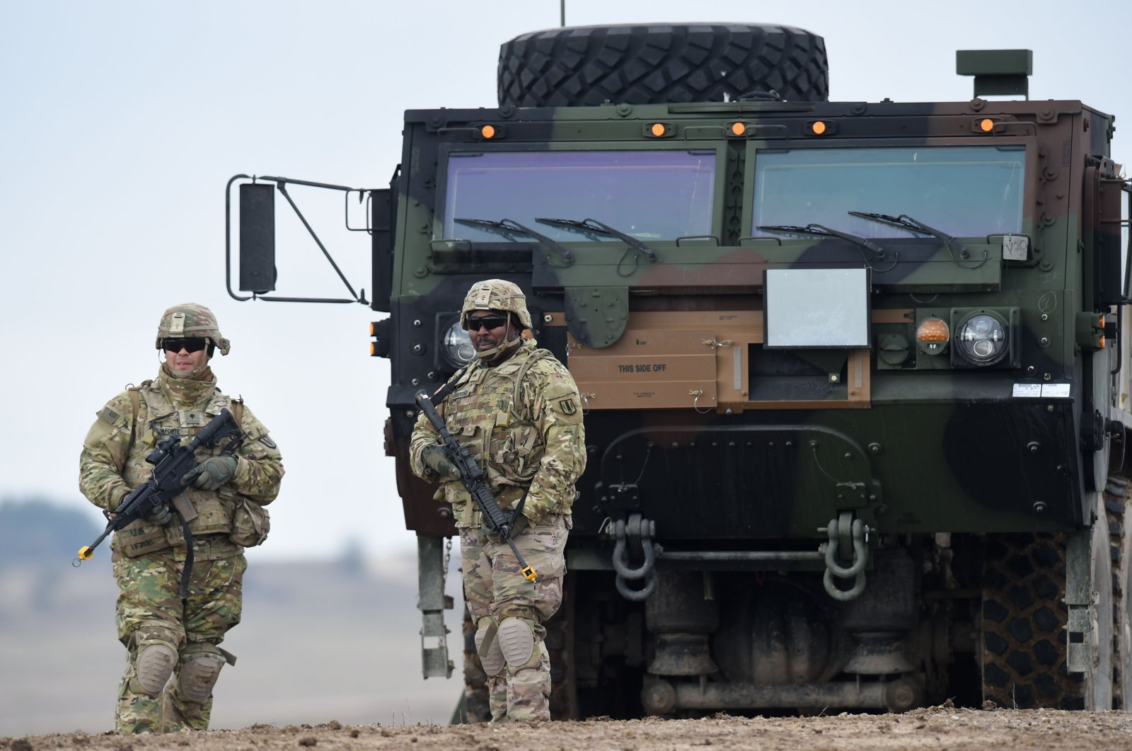U.S. soldiers patrol prior to an artillery live-fire event by the U.S. Army Europe's 41st Field Artillery Brigade at the military training area in Grafenwoehr, Germany, March 4, 2020. (AFP Photo)