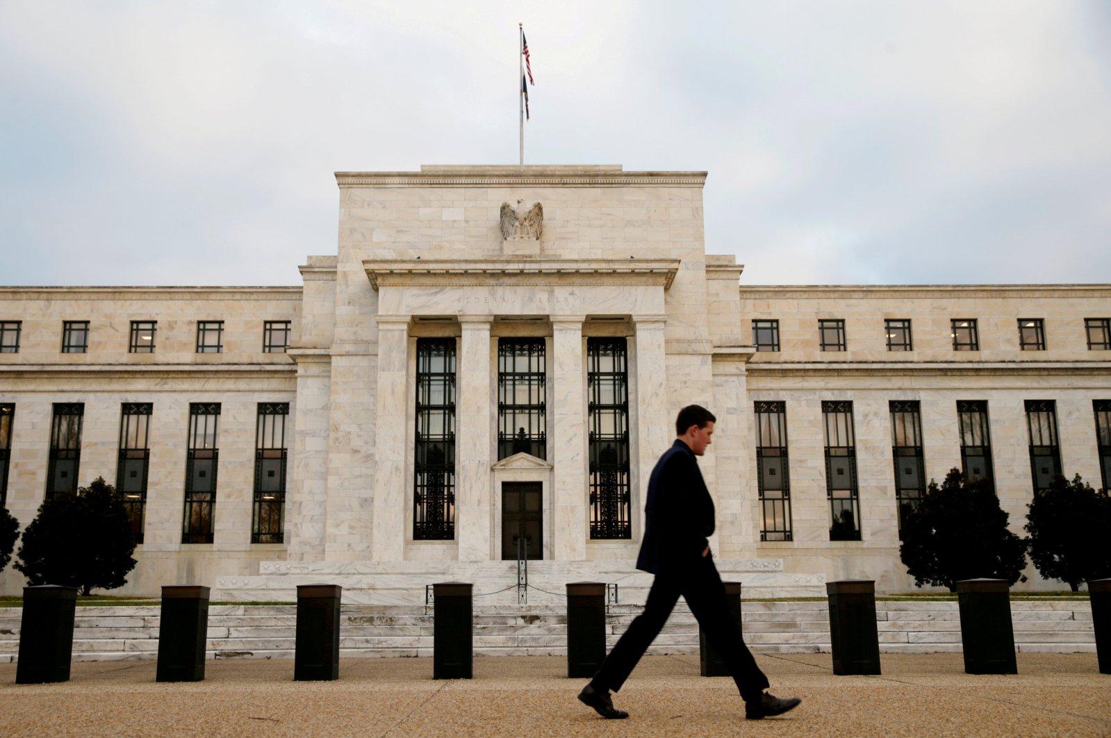 A man walks past the Federal Reserve Bank in Washington, D.C., U.S., Dec. 16, 2015. (Reuters Photo)