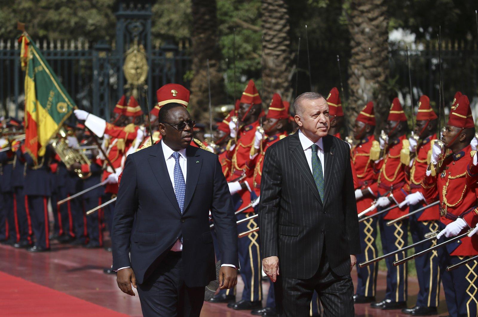 President Recep Tayyip Erdoğan and his Senegalese counterpart Macky Sall salute Senegalese soldiers during Erdoğan's visit to Dakar, Jan. 29, 2020. (AA)