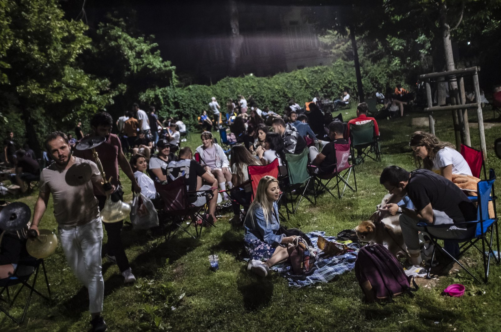 People sit in a park in Istanbul, Turkey, June 7, 2020. (DHA Photo)