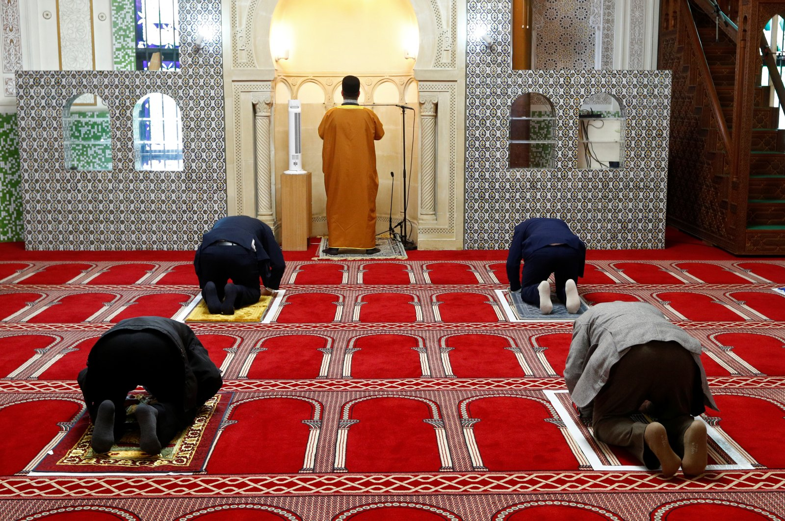 Muslims pray amid social distancing markers at the Grand Mosque, after weeks of lockdown restrictions following the coronavirus outbreak, Brussels, Belgium, June 8, 2020. (Reuters Photo)