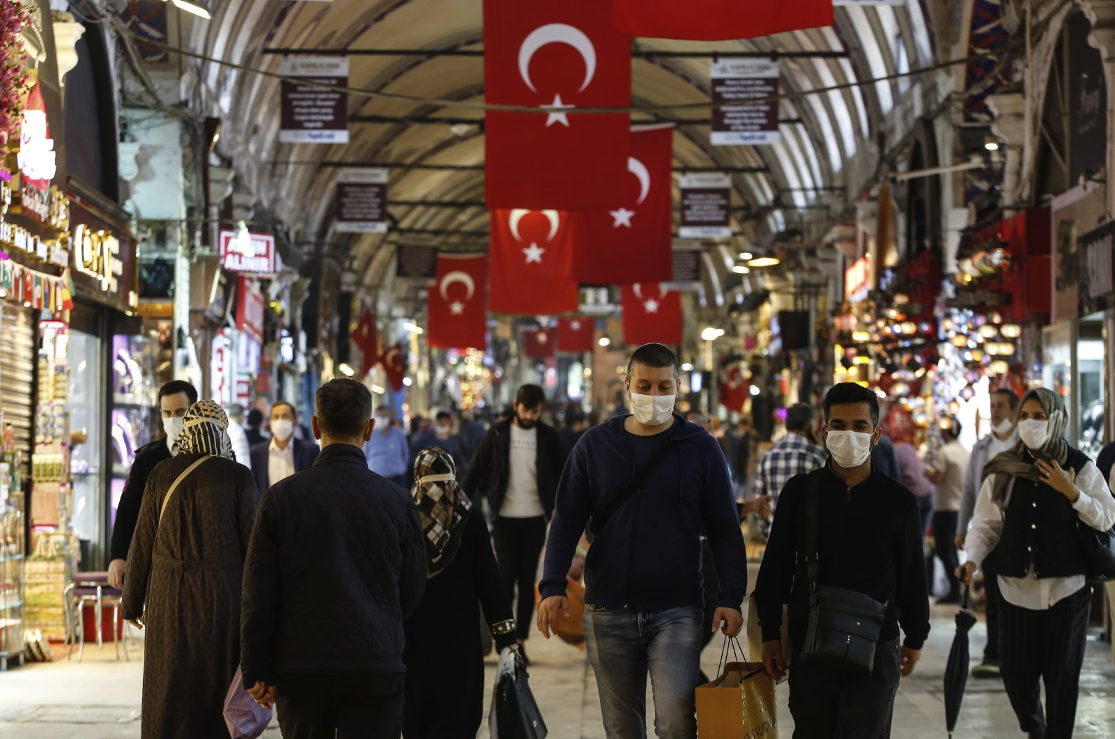 People wearing protective face masks walk at the iconic 15th century Grand Bazaar in Istanbul, Turkey, Monday June 1, 2020. (AP Photo)