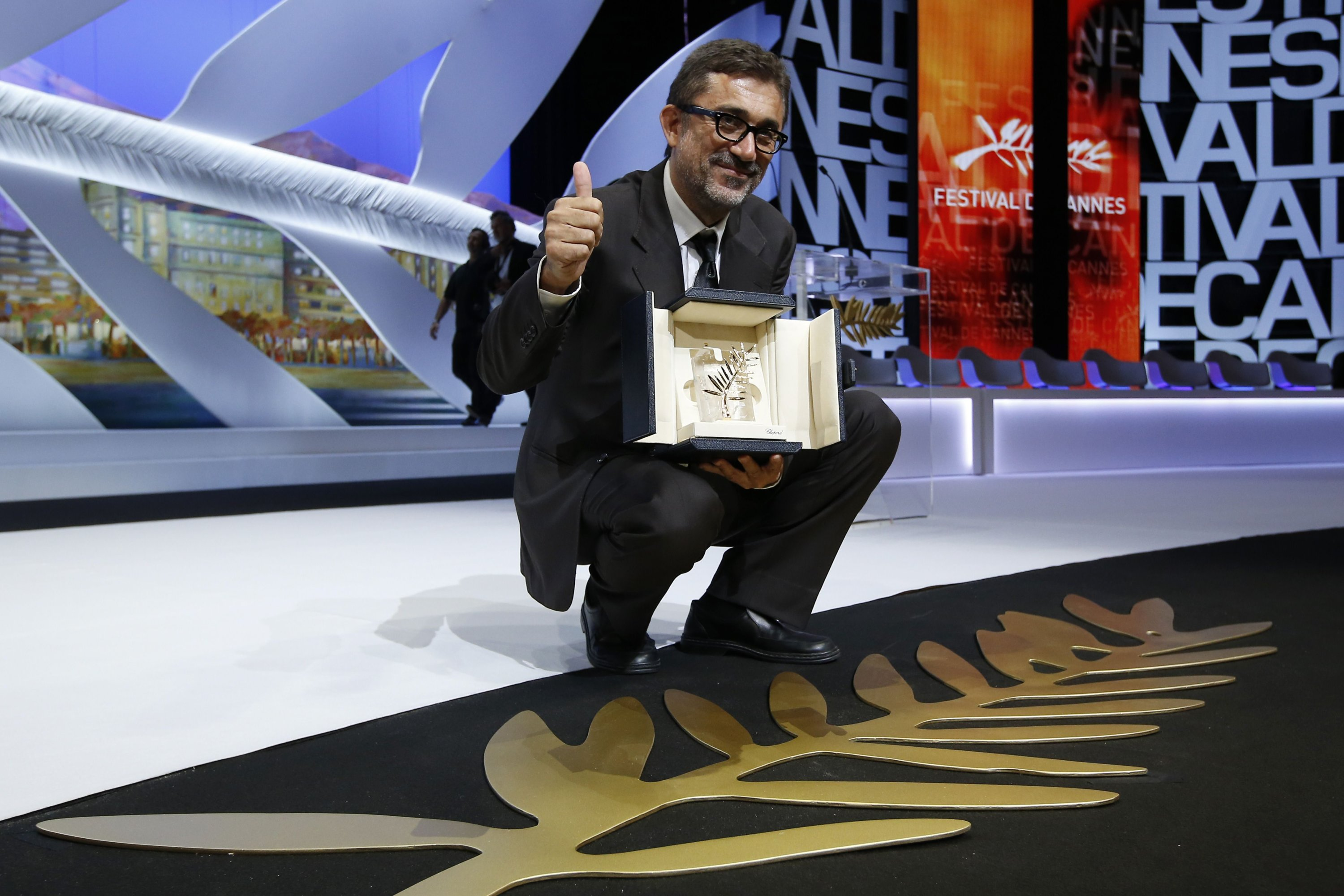 Turkish director Nuri Bilge Ceylan poses with the Palme d'Or for the film