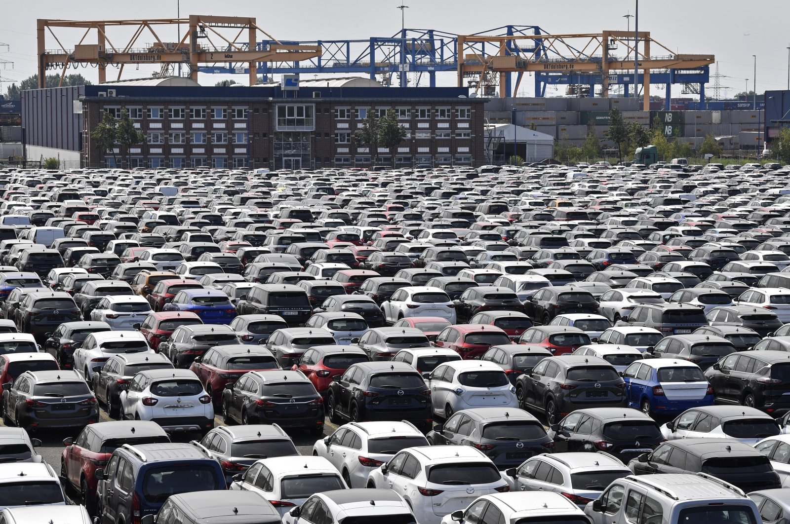 New cars are stored at the 'logport' (logistic port) in Duisburg, Germany, Wednesday, June 3, 2020. (AP Photo)