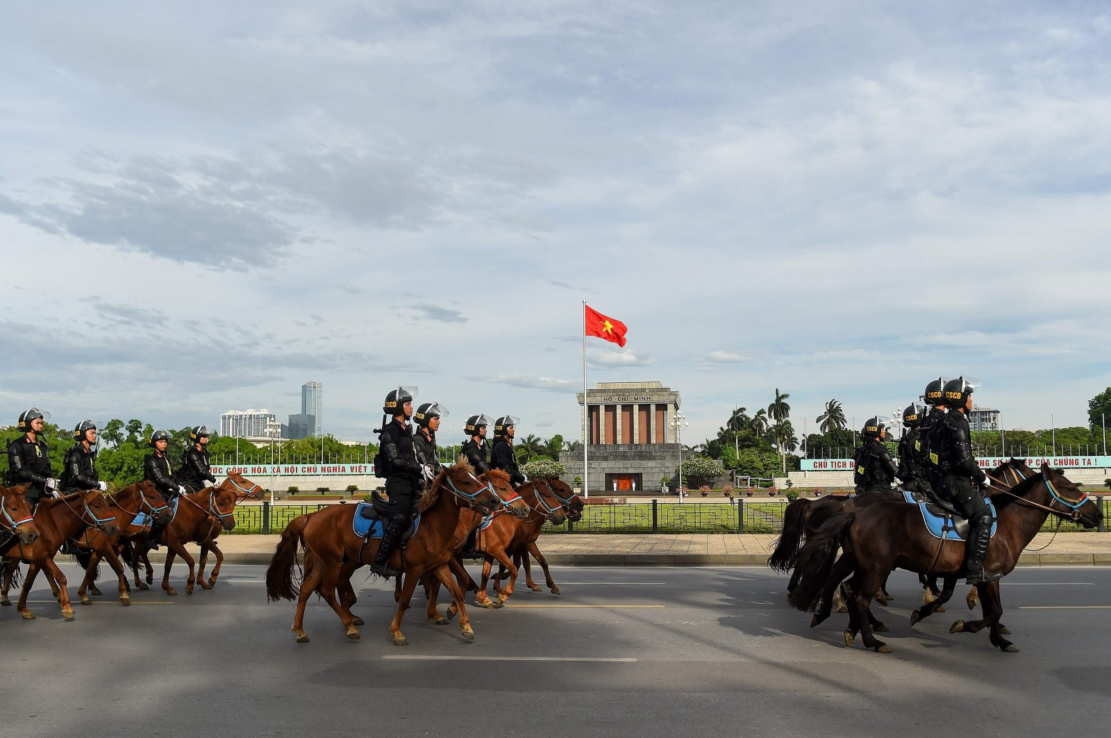 Mounted police personnel parade on horses past the Ho Chi Minh mausoleum in Hanoi, Vietnam, June 8, 2020. (AFP Photo)